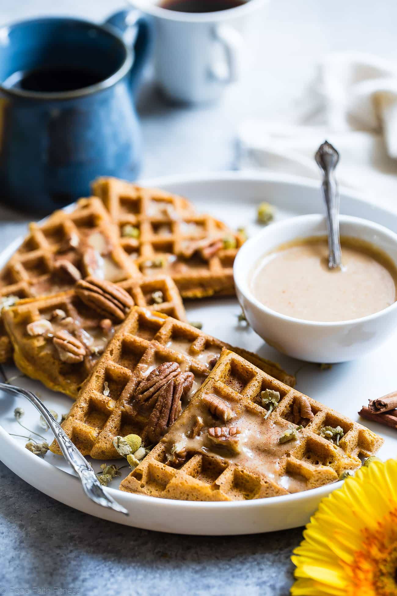 The BEST Pumpkin Spice Paleo Waffles with Pumpkin Cream Sauce - SO light, crispy and airy that you will NEVER believe that these are vegan friendly and gluten, grain, dairy AND sugar free! | Foodfaithfitness.com | @FoodFaithFit