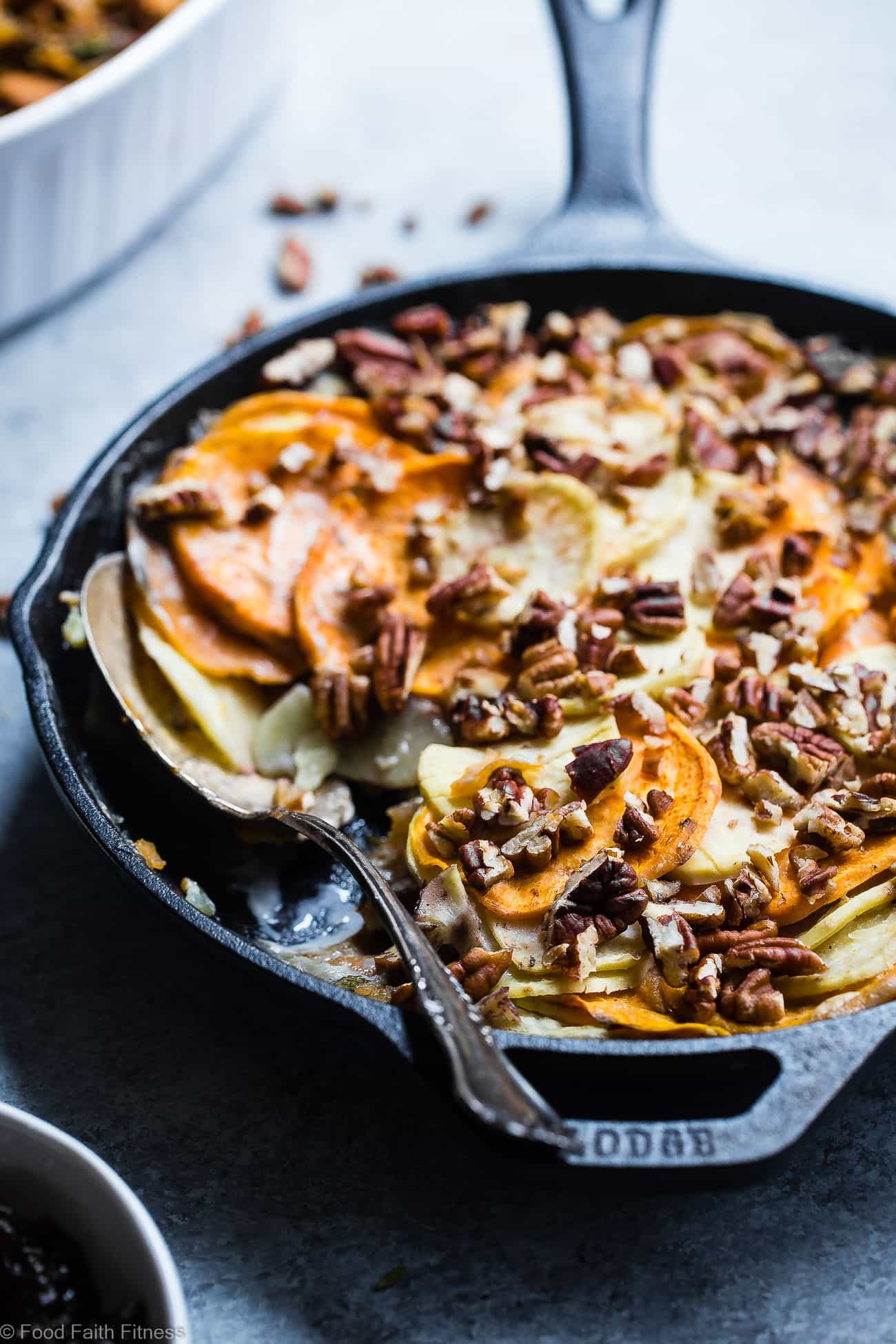 Sweet Potato Scalloped Potatoes Casserole - So rich and creamy, you will never believe it's gluten free and paleo/vegan/whole30 compliant! Perfect for a healthy Thanksgiving! | Foodfaithfitness.com | @FoodFaithFit