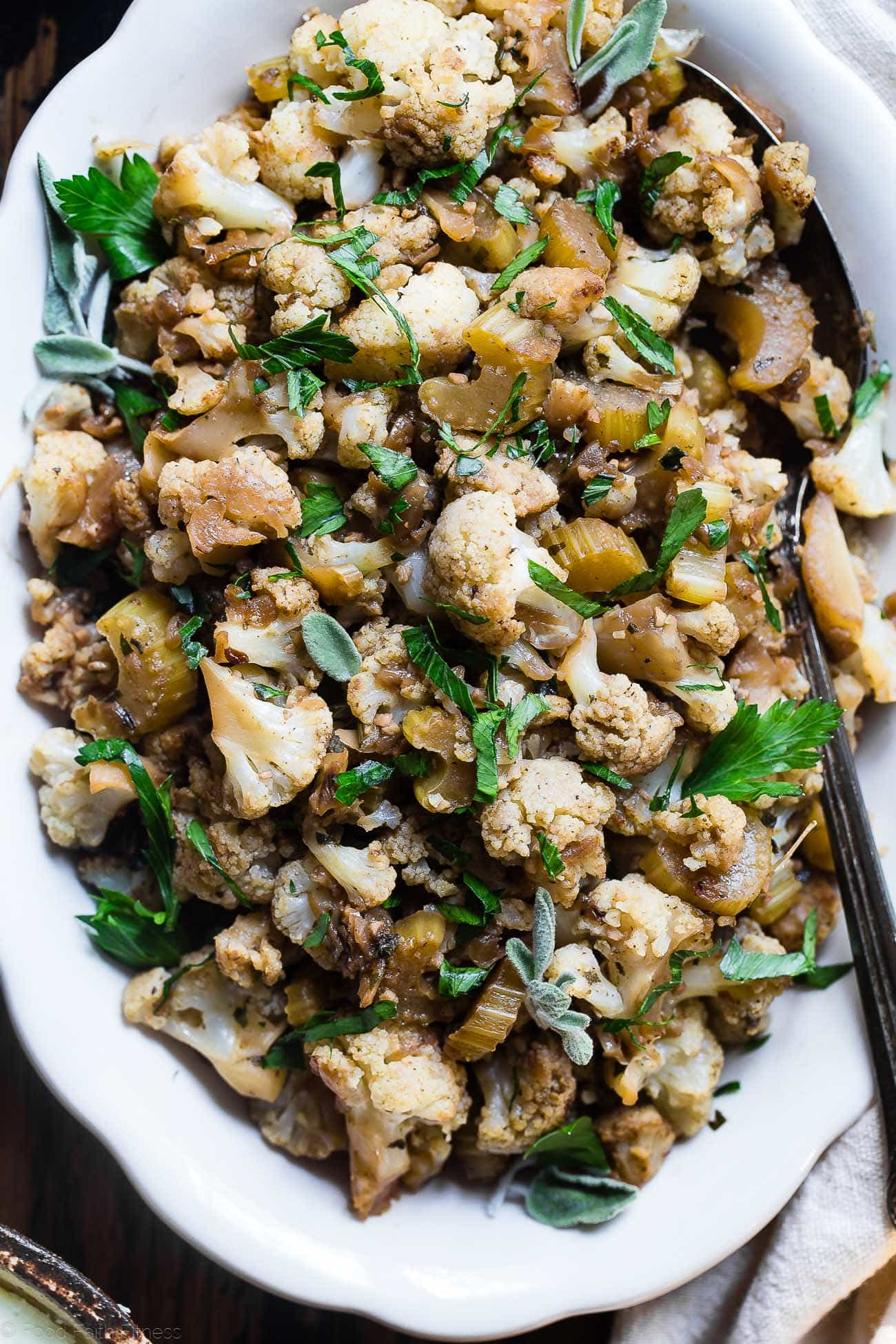 Low Carb Cauliflower Stuffing - This low carb stuffing recipe is made entirely from vegetables but has all the flavor of traditional bread stuffing! It's super easy, whole30 compliant, paleo, vegan, gluten free and SO delicious! Perfect for Thanksgiving or Christmas! | Foodfaithfitness.com | @FoodFaithFit