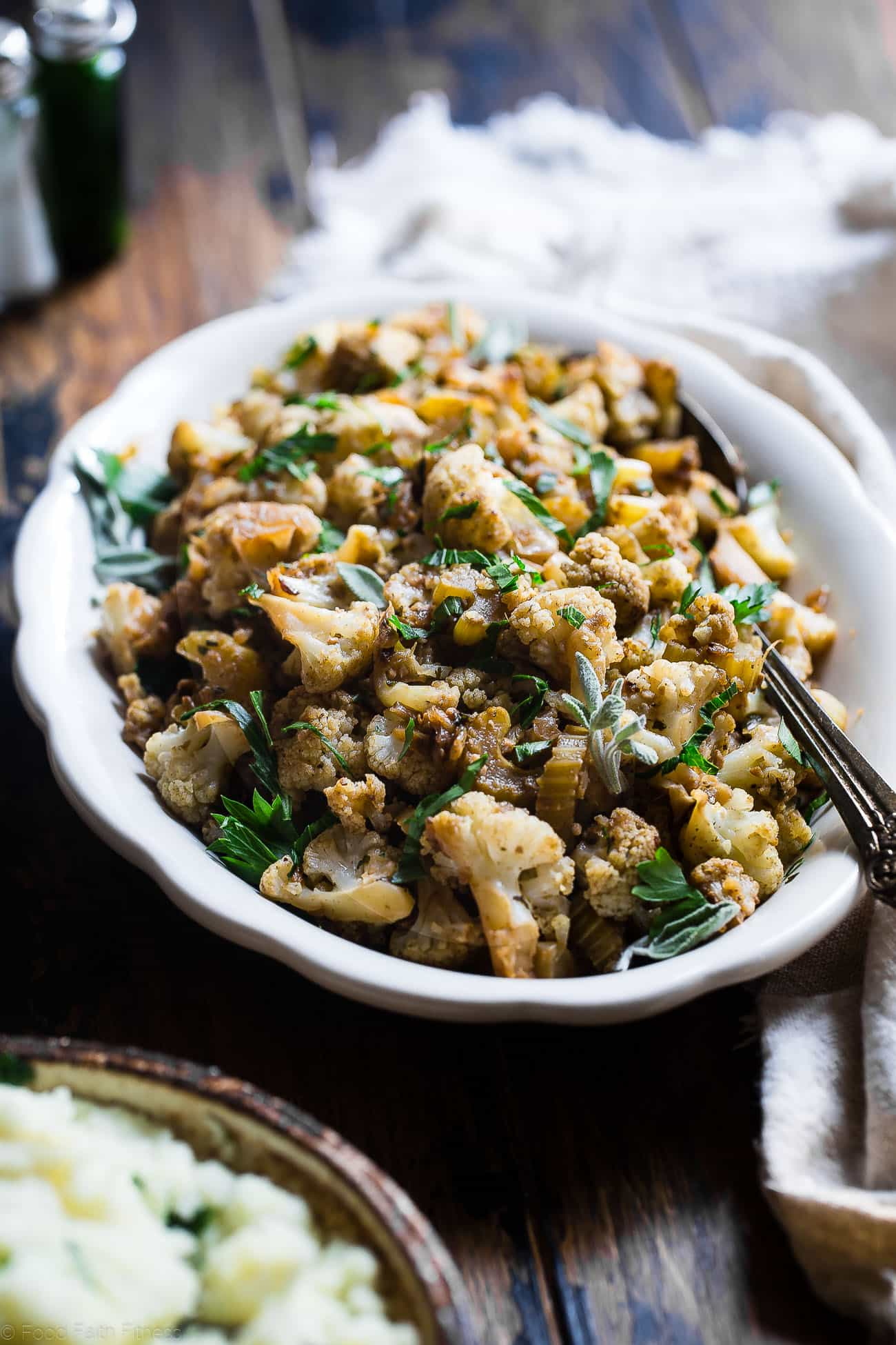 Cauliflower Low Carb Paleo Vegan Stuffing - This paleo thanksgiving stuffing is made entirely from vegetables but has all the flavor of traditional bread stuffing! It's super easy, whole30 compliant, paleo, vegan, gluten free and SO delicious! Perfect for Thanksgiving or Christmas! | Foodfaithfitness.com | @FoodFaithFit