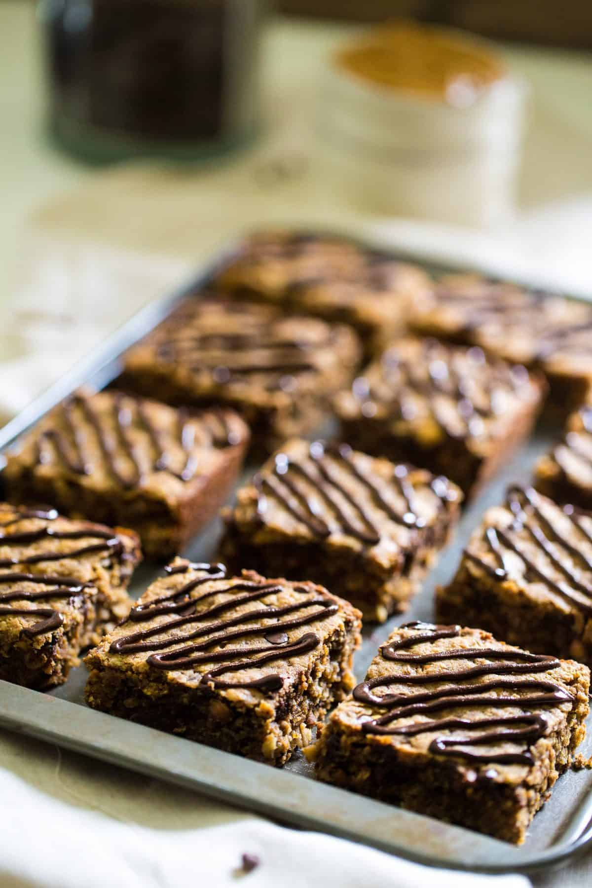 16 healthy peanut butter oatmeal breakfast bars on a baking sheet