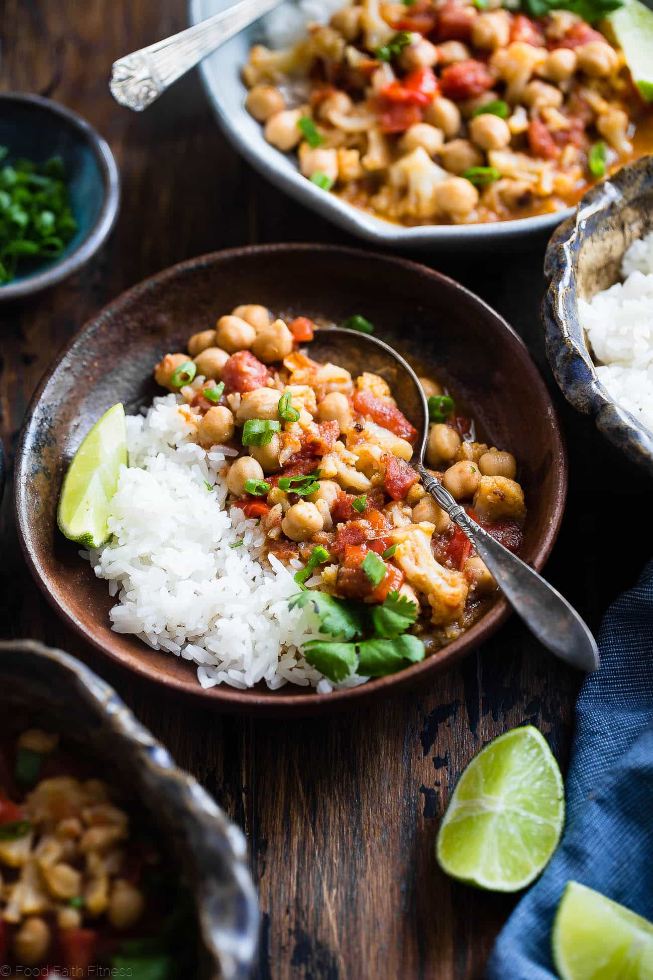 Instant Pot Vegan Chickpea Curry - This easy chickpea curry recipe is made in the Instant Pot and ready in 20 mins! It uses coconut milk and tomatoes to make it thick and so creamy! Makes great leftovers and is great for meal prep! | Foodfaithfitness.com | @FoodFaithFit