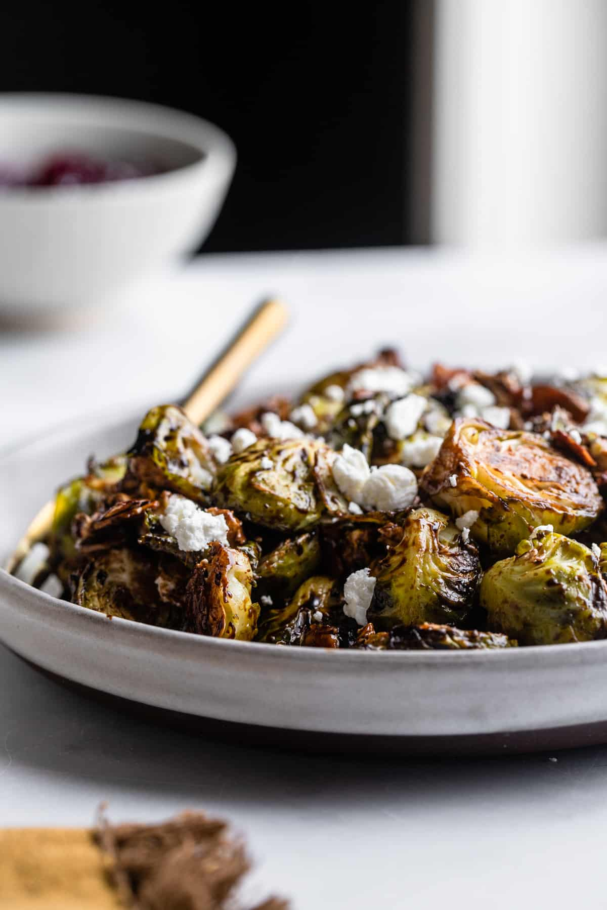 a plate of Roasted Balsamic Brussels on a table