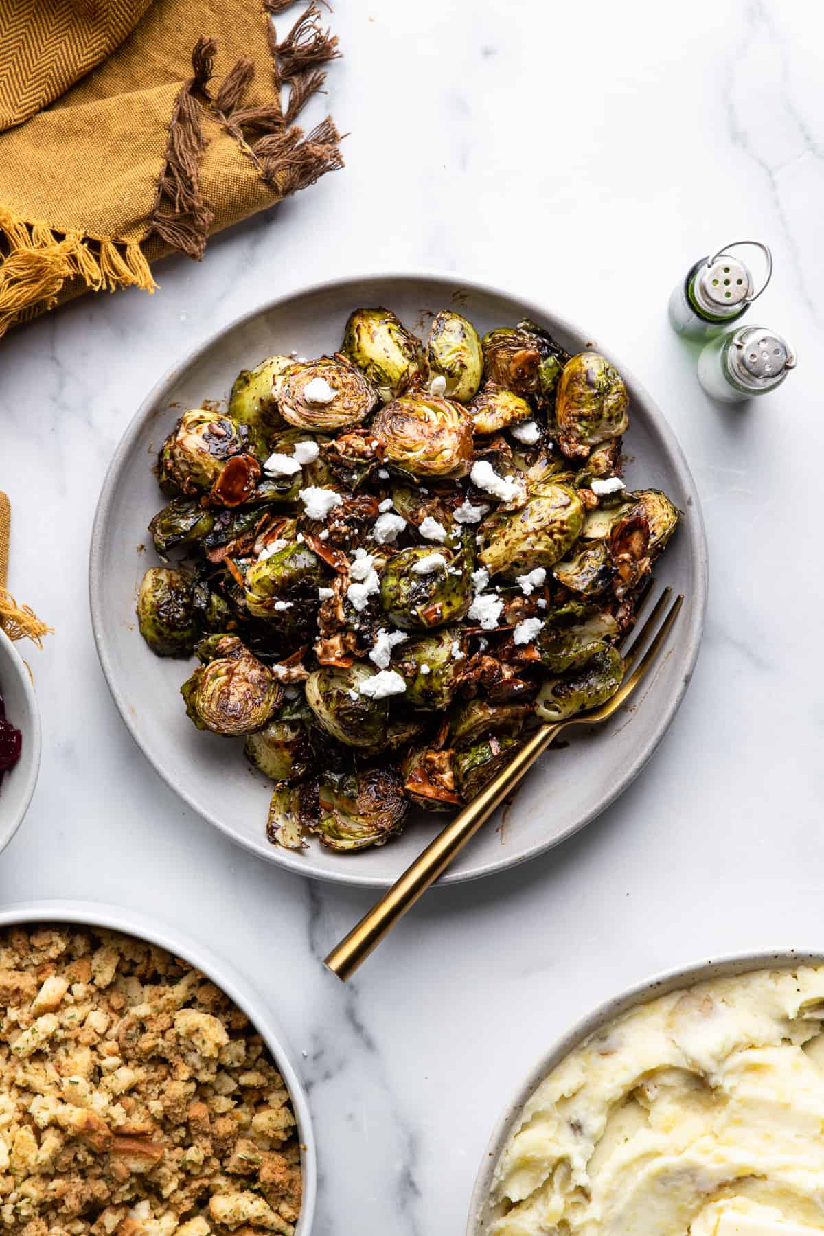 a large plate with Roasted Balsamic Brussels and a fork
