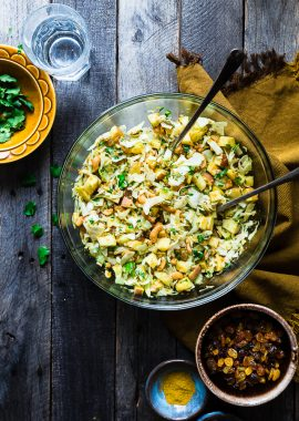 Curry Cashew Shredded Cabbage Salad with Apples - A sugar and gluten free healthy salad that is mixed witha creamy curry dressing and crunchy cashews! A healthy, paleo and whole30 side dish that everyone will love!   Foodfaithfitness.com   @FoodFaithFit