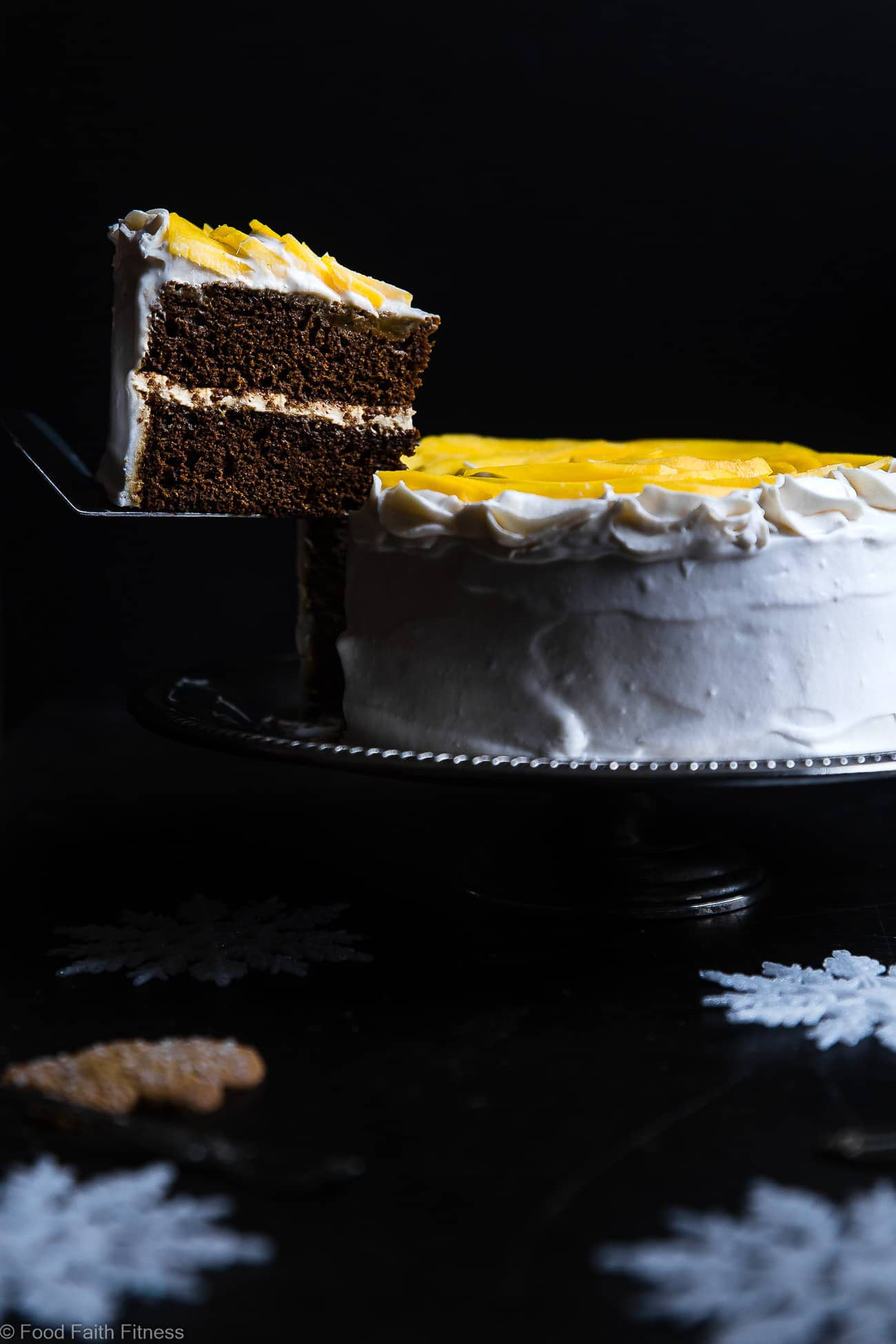 Gluten Free Mango Gingerbread Cake with Coconut Cream -This spicy-sweet, show stopping gluten free gingerbread cake is studded with juicy, fresh mangoes to create a healthy, paleo-friendly, festive dessert for the Holidays! | Foodfaithfitness.com | @FoodFaithFit