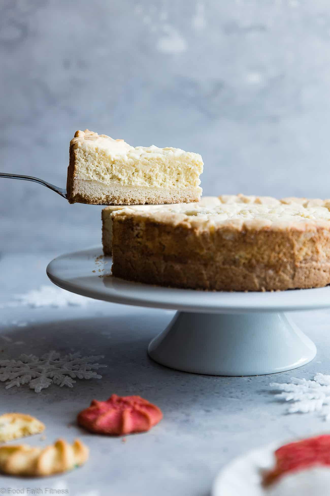Sugar Cookie Greek Yogurt Gluten Free Cheesecake -This gluten free cheesecake is an easy dessert that combines 2 Holiday treats ! It's so creamy you won't believe it's healthy, sugar free and only 235 calories! | Foodfaithfitness.com | @FoodFaithFit