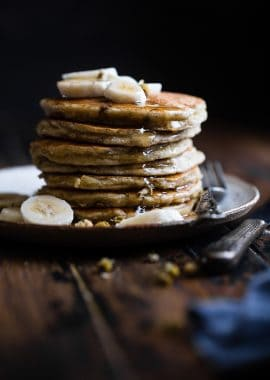 Easy Paleo Banana Pancakes -Thesequick and easy banana pancakesare naturally sweetened, gluten, grain and dairy free and SO light and fluffy! The perfect healthy start to your day or weekend breakfast! | Foodfaithfitness.com | @FoodFaithFit