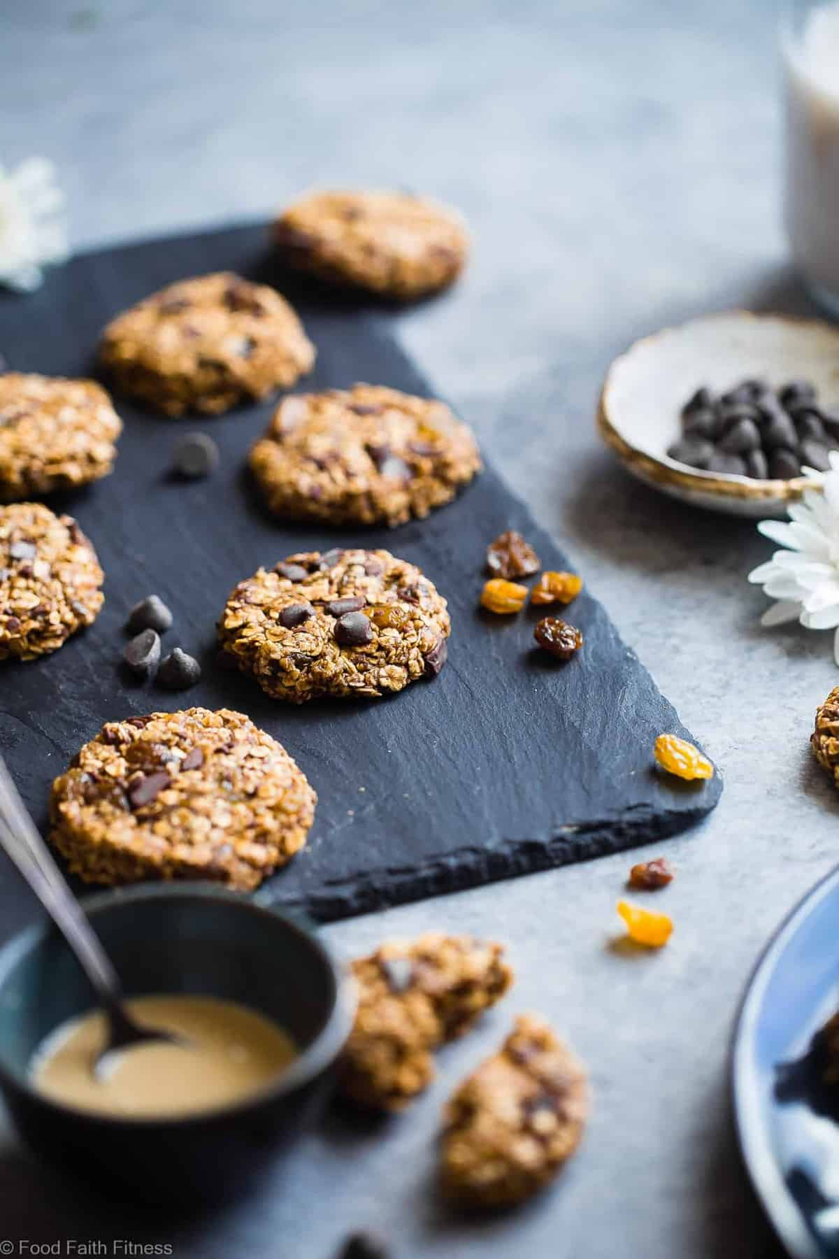Vegan Gluten Free Oatmeal No Bake Cookies - These EASY, no bake oatmeal cookies have a surprise tahini twist, chocolate and notes of spicy cardamon and chewy golden raisins! A healthy, gluten/dairy/egg free treat for only 110 calories! | #Foodfaithfitness | #Vegan #NoBake #Healthy #ChocolateChip #Glutenfree