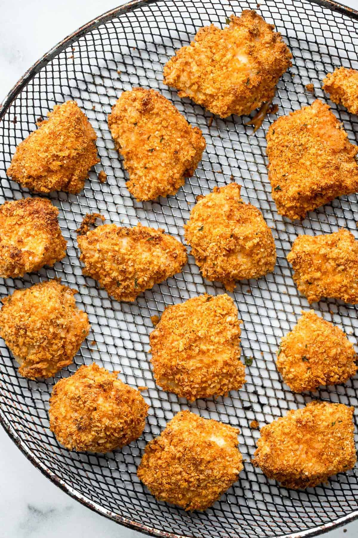 Air fryer chicken nuggets arranged on a backing rack
