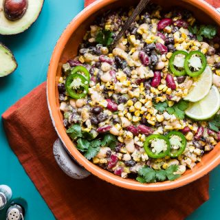 Three Bean Mexican Corn Black Bean Salad - This quick and easy, healthy three bean salad has a Mexican twist with an avocado salsa dressing! It's the perfect Summer side and it's gluten free, vegan and only one Weight Watchers Freestyle point! | #Foodfaithfitness | #Glutenfree #Vegan #Weightwatchers #Healthy #July4th