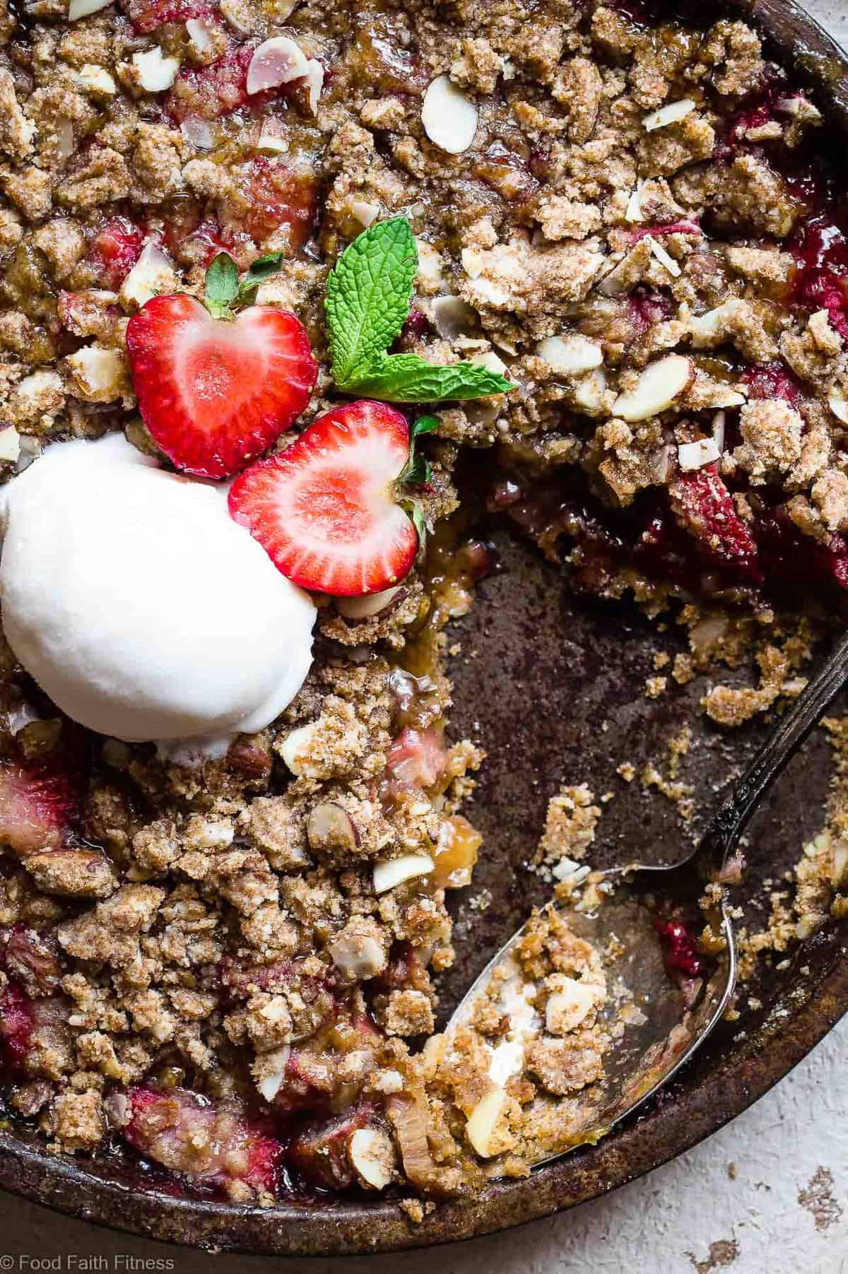 gluten free rhubarb crumble close-up in serving dish with spoon