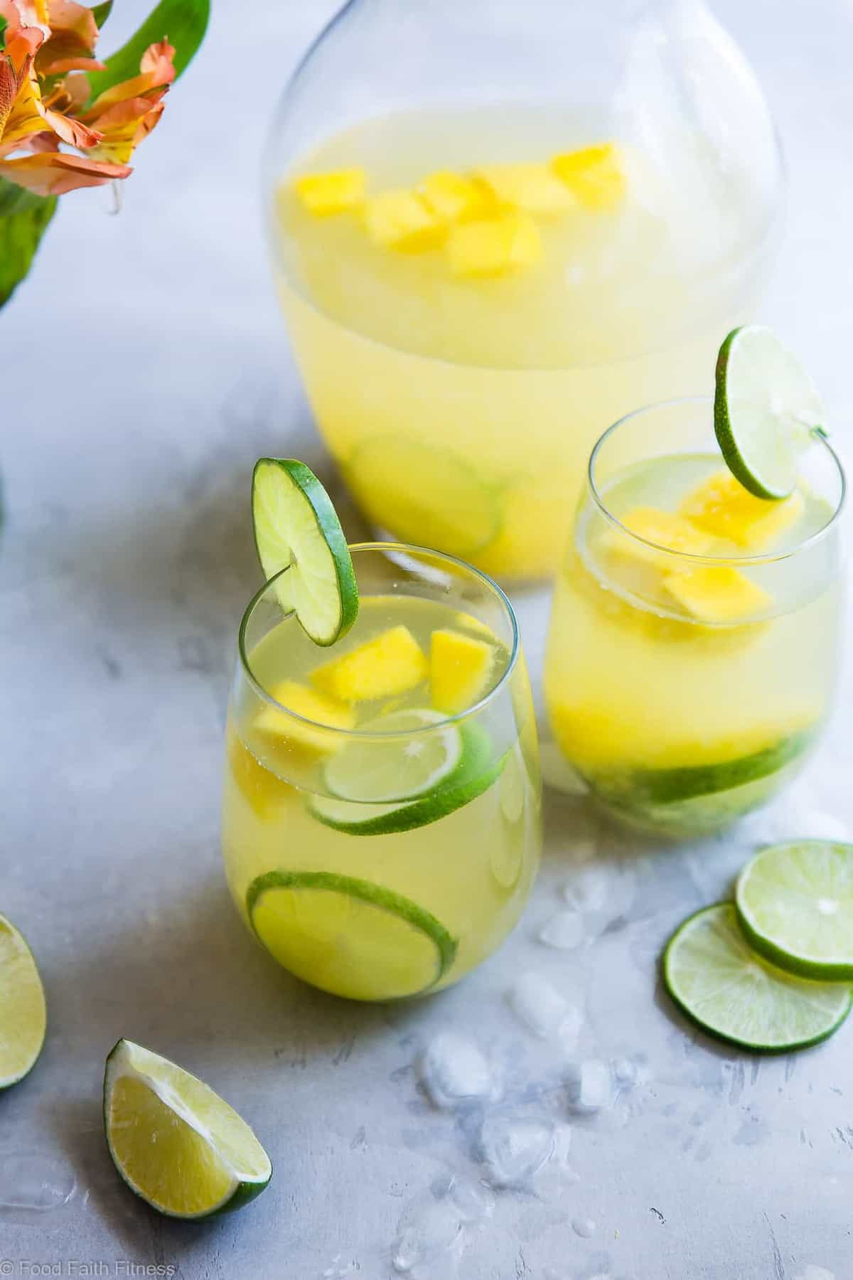 Tropical White Moscato Sangria -This easy, island styleWhite Moscato Sangria recipe is a SUPER easy cocktail, perfect for Summer parties! Made with better for you ingredients and SO tasty! | #Foodfaithfitness | #Sangria #Glutenfree #Healthy #DairyFree #Cocktail