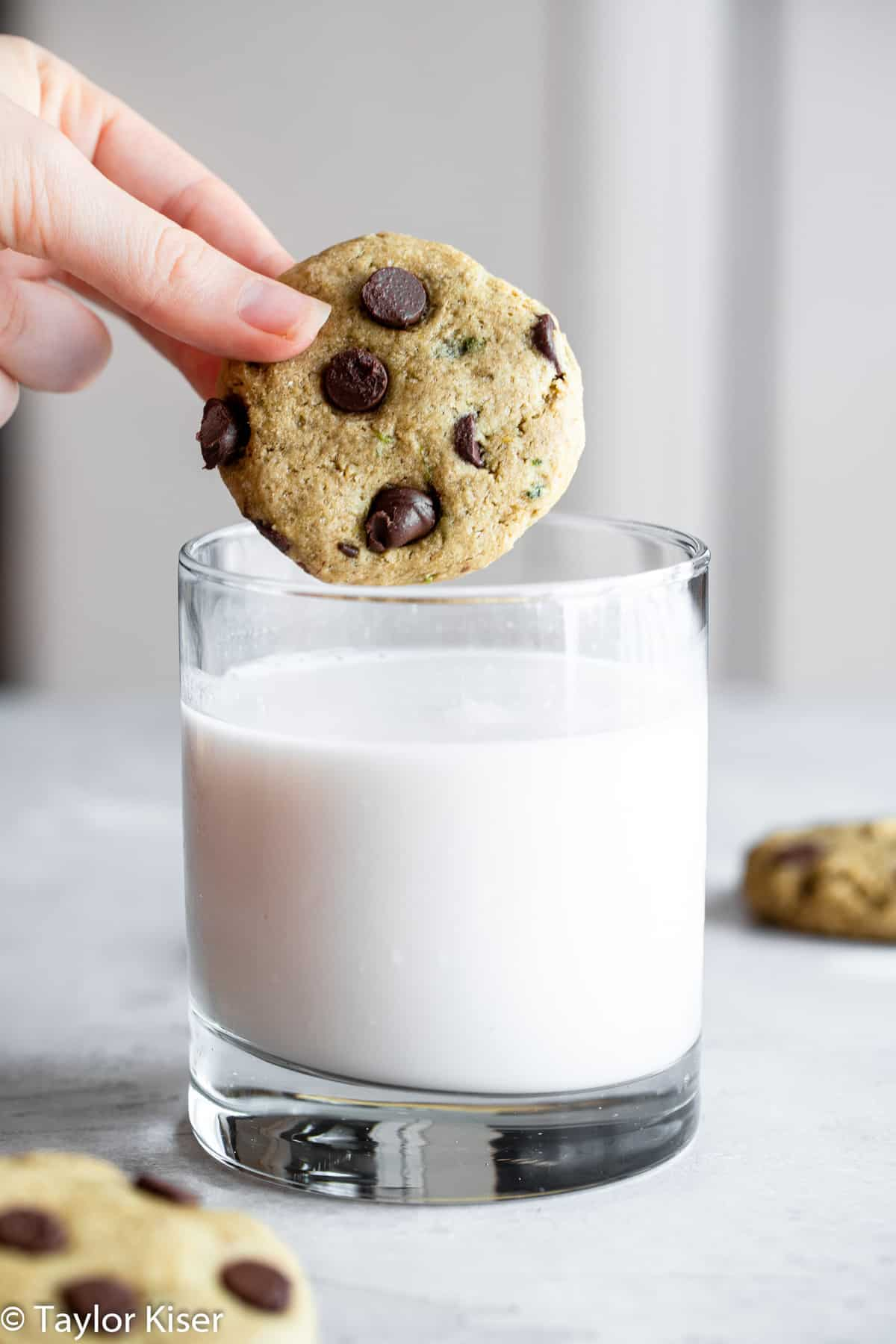 Healthy Chocolate Chip Cookie being dipped into a glass of milk