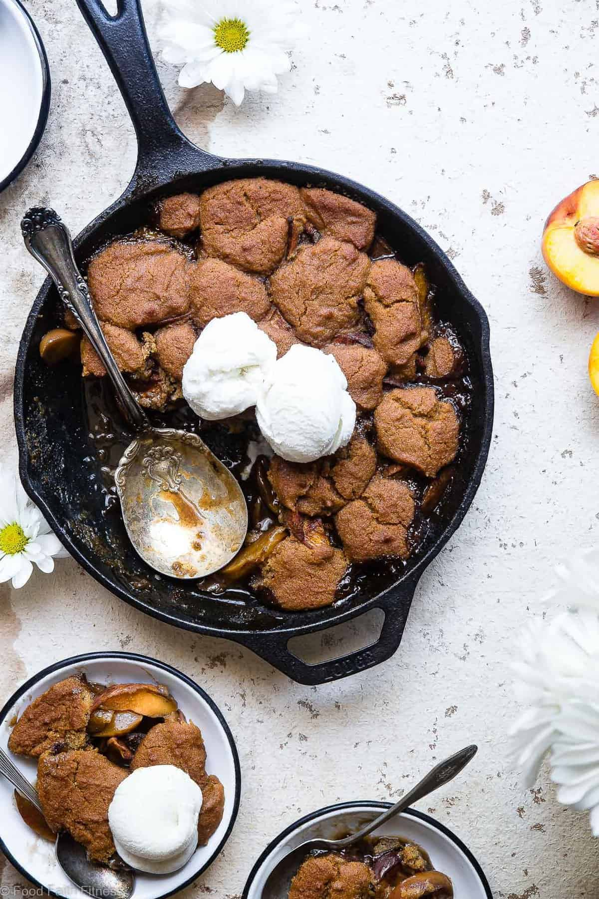 paleo peach cobbler served with ice cream in a large skillet pan