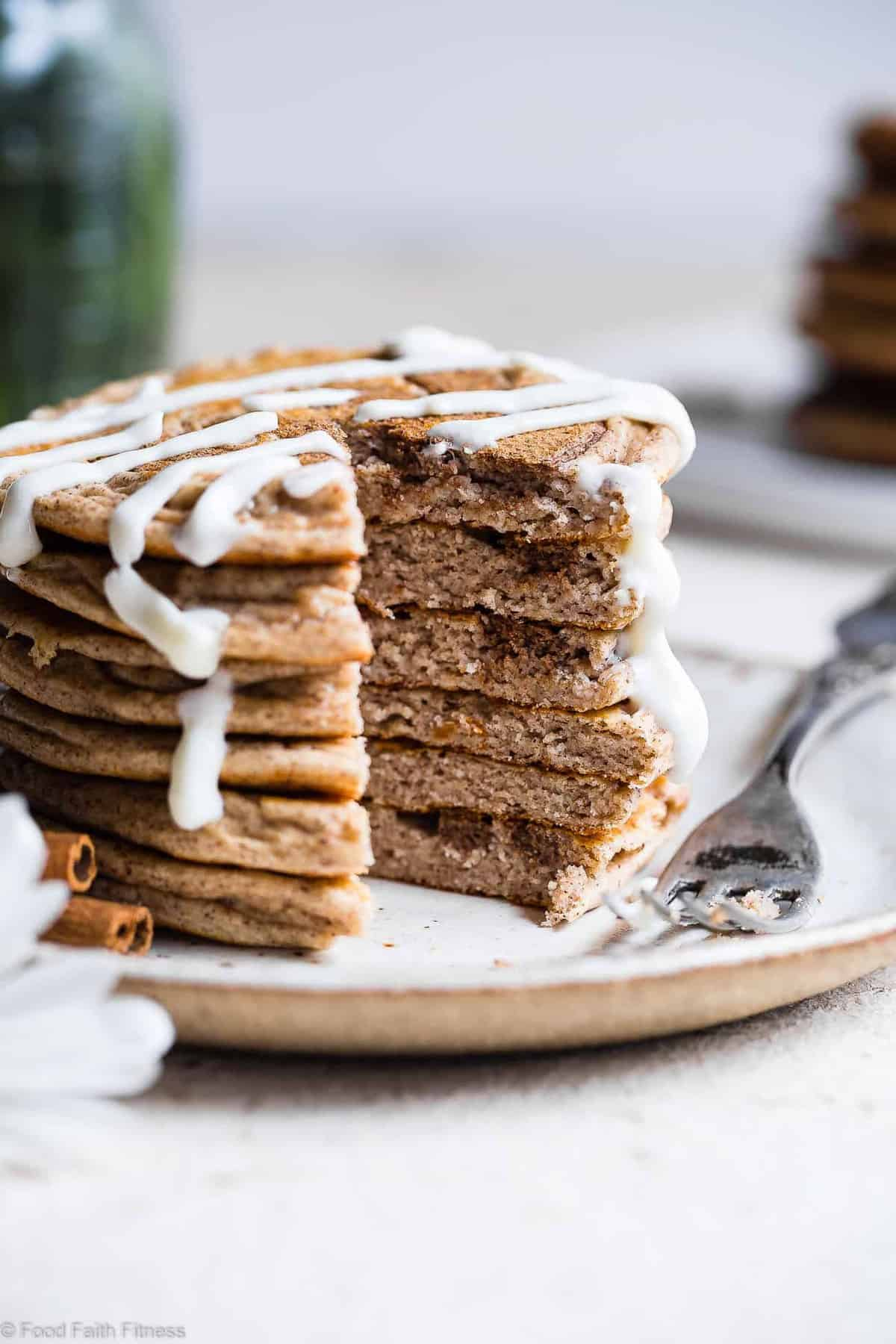 Cinnamon Roll Keto Protein Pancakes - This EASY, low carb, gluten free healthy protein pancakes recipe is going to be your new favorite breakfast! Great for kids and adults and packed with 23g of protein! Who doesn't want to wake up to healthy cinnamon rolls?! | #Foodfaithfitness | #Keto #Lowcarb #Glutenfree #Healthy #Pancakes