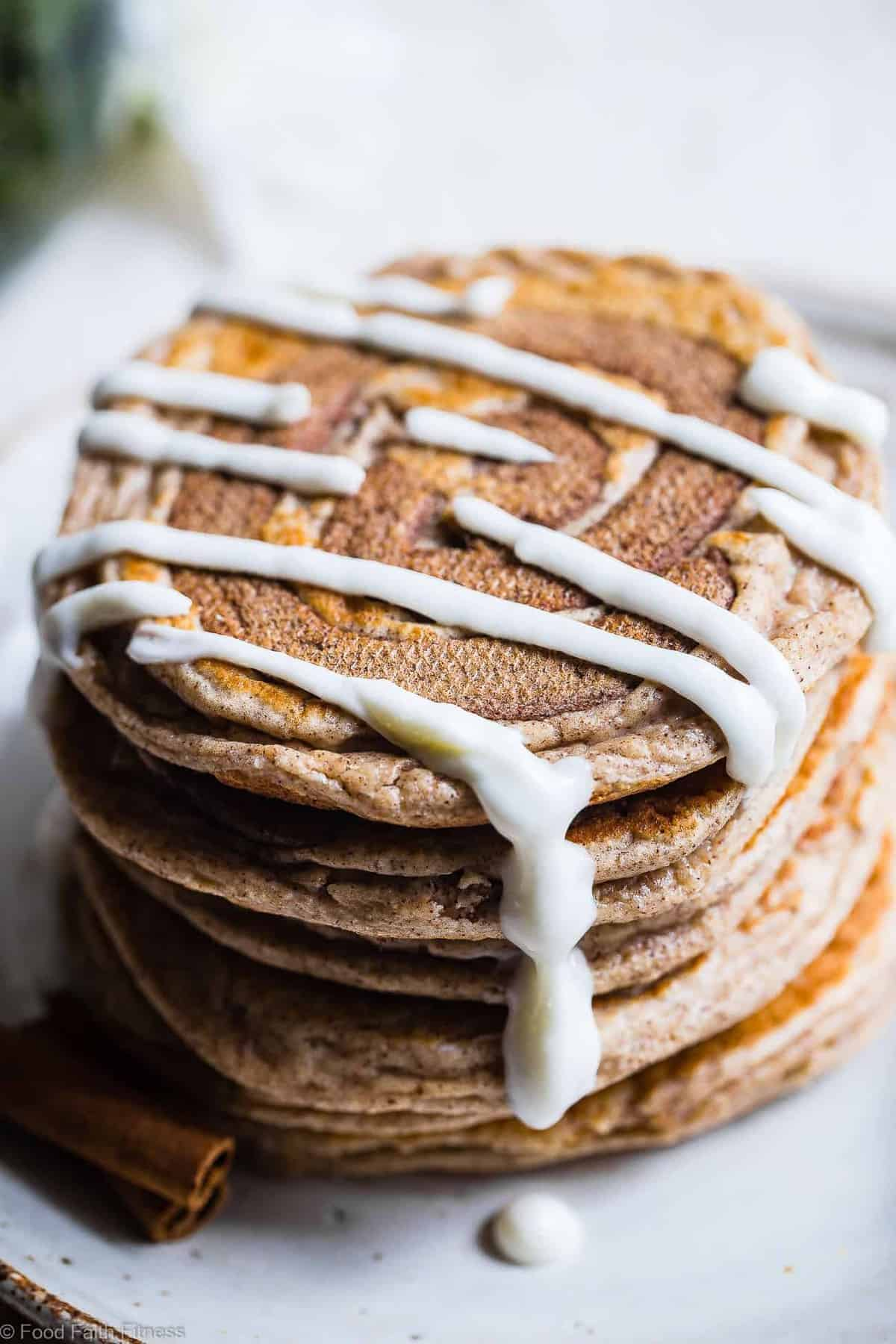 Cinnamon Roll Keto Protein Pancakes - This EASY, low carb, gluten free protein pancakes recipe is going to be your new favorite breakfast! Great for kids and adults and packed with 23g of protein! Who doesn't want to wake up to healthy cinnamon rolls?! | #Foodfaithfitness | #Keto #Lowcarb #Glutenfree #Healthy #Pancakes