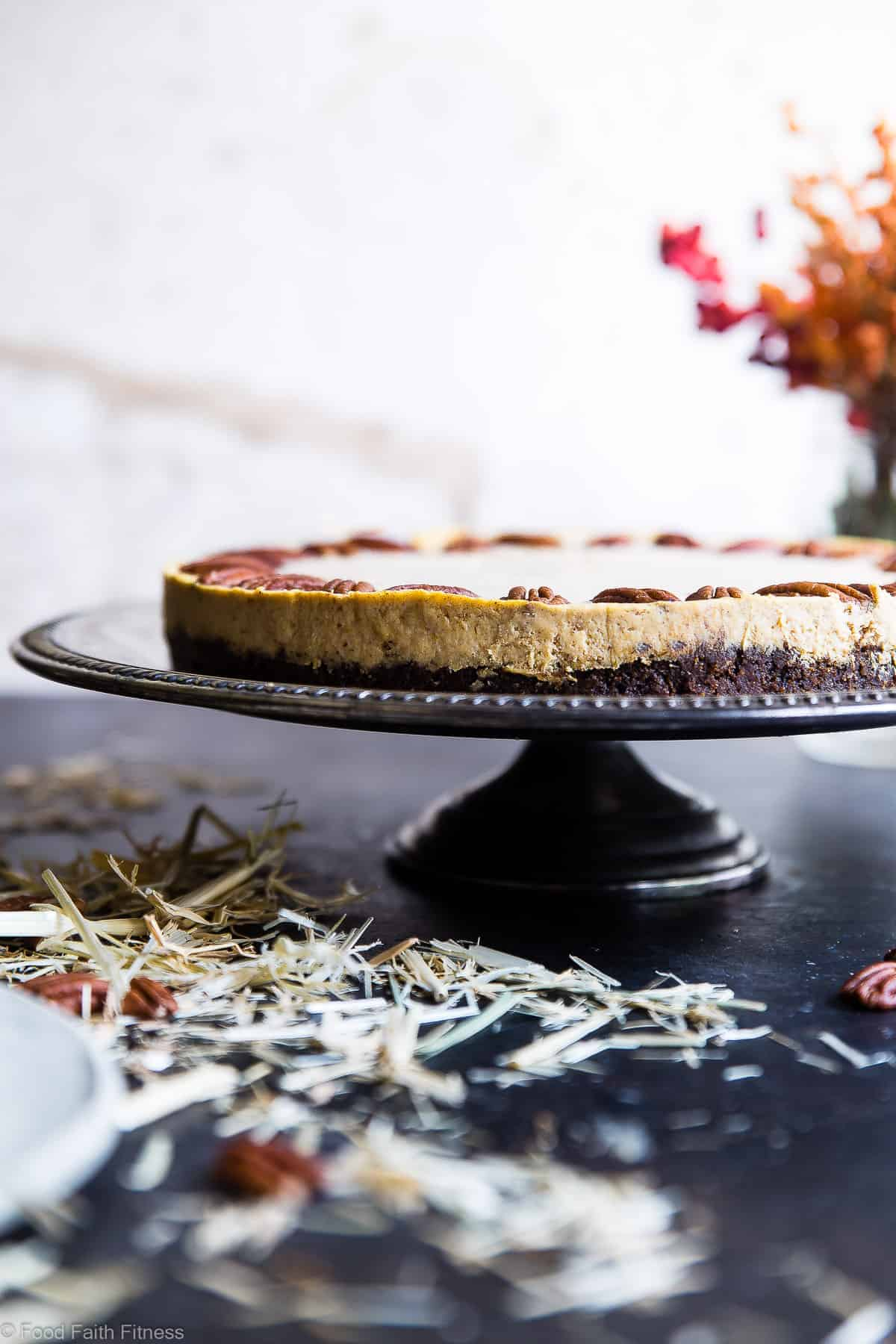 Low Carb Keto Pumpkin Cheesecake - This healthy low carb pumpkin cheesecakeis SO creamy and spicy-sweet you will never believe it's gluten, grain and sugar free and only 240 calories! The BEST fall dessert ever! | #Foodfaithfitness | #Glutenfree #Keto #Lowcarb #Pumpkin #Sugarfree