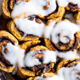 Gluten Free Vegan Pumpkin Cinnamon Rolls -These easy Pumpkin Spice Cinnamon Rolls are so soft and fluffy you won't believe they're gluten, dairy and egg free! Loaded with spicy-sweet fall flavor and SO delicious! | #Foodfaithfitness | #Glutenfree #vegan #dairyfree #eggfree #pumpkin