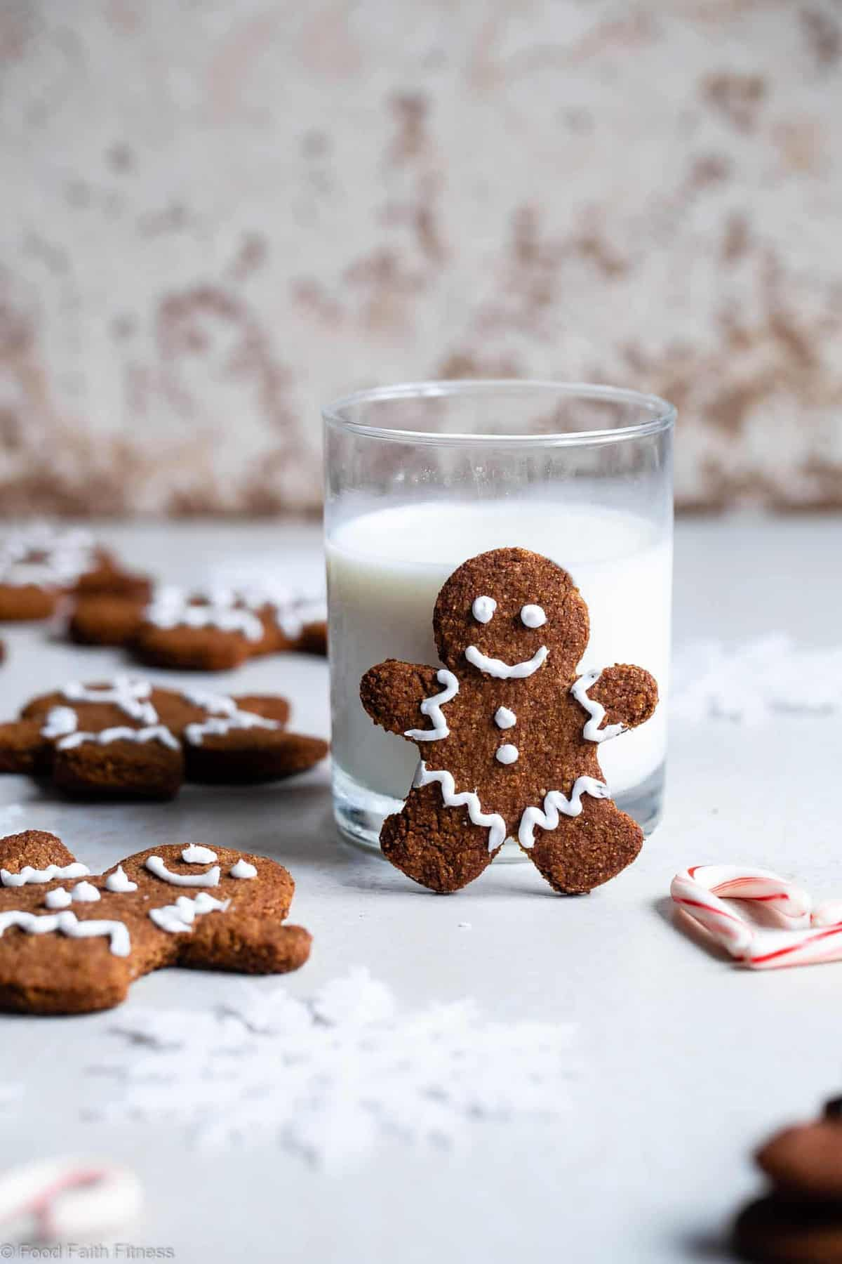 Gluten Free Paleo Gingerbread Cookies - These gingerbread cookies are perfectly spicy, sweet and crispy! An easy, delicious holiday cookie that no one will know are healthy and gluten/grain/dairy/refined sugar free! | #Foodfaithfitness | #Glutenfree #paleo #Gingerbread #healthy #dairyfree
