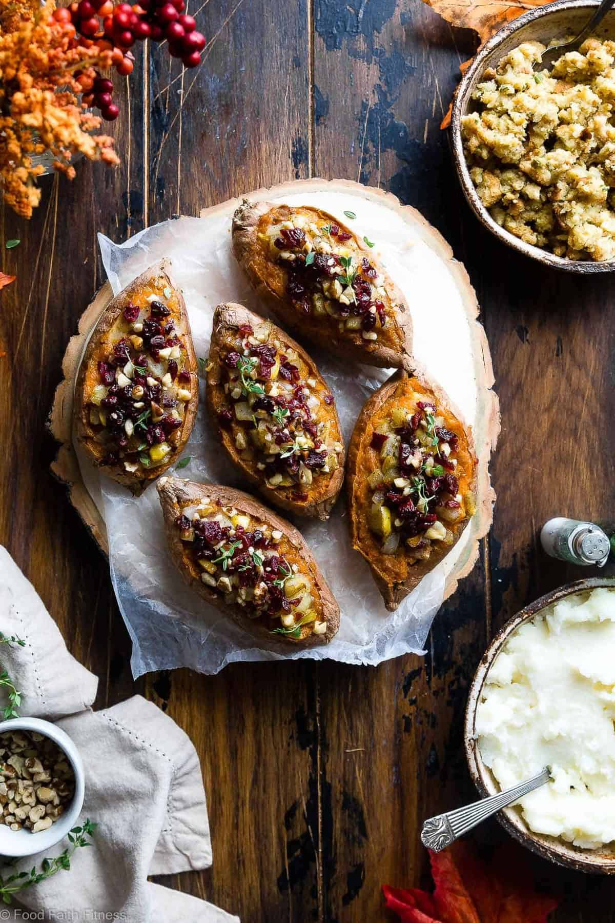 Harvest Paleo Vegan Stuffed Sweet Potatoes - These healthy stuffed sweet potatoes are loaded with cozy, spicy-sweet fall flavors like cranberries, walnuts and pears and are SO easy to make! Gluten, grain and dairy free and whole30 compliant too! | #Foodfaithfitness | #Paleo #Vegan #Glutenfree #Healthy #Whole30
