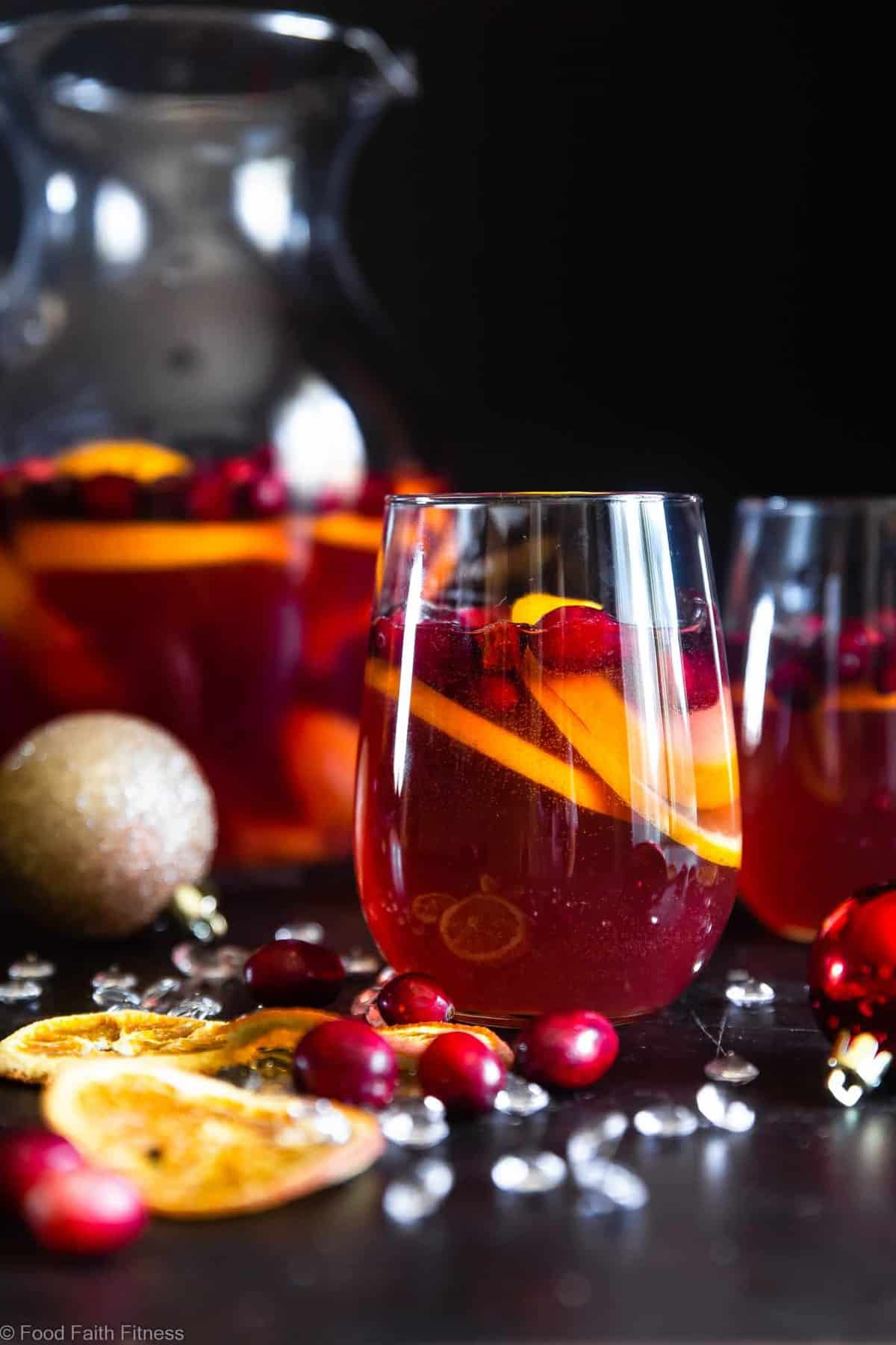 Holiday Sparkling Sangria - Full of tart cranberries and sweet oranges, this is an easy, better-for-you cocktail that is perfect to serve a crowd this Holiday season! Fizzy, festive and tasty! | #Foodfaithfitness |