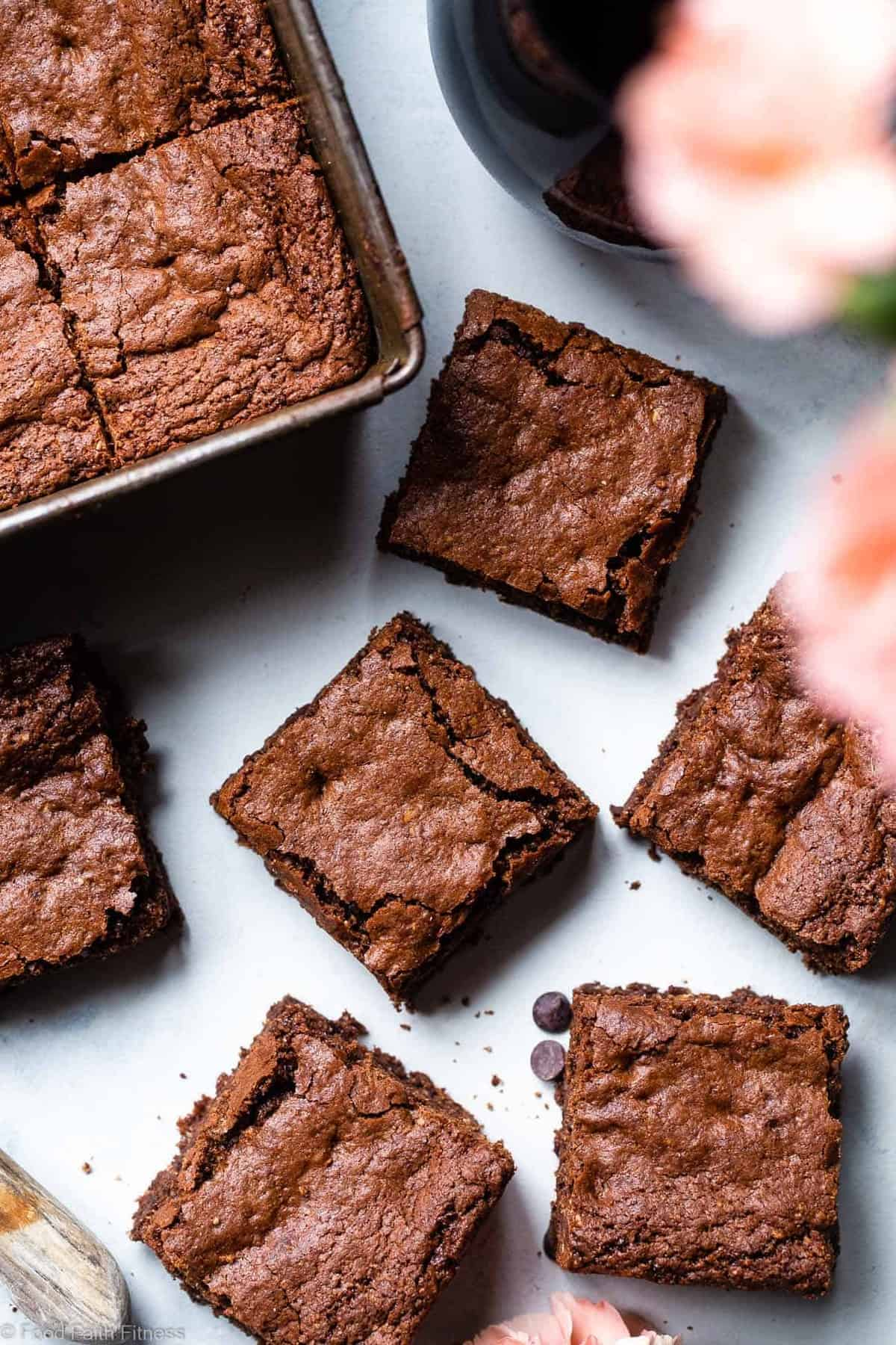 Easy Gluten Free Dairy Free Brownies - These grain free, healthy brownies come together in less than an hour and are SO dense, chewy and FUDGY! Paleo friendly, gluten and dairy free and SO delicious! | #Foodfaithfitness | #Glutenfree #Dairyfree #Paleo #Healthy #Brownies