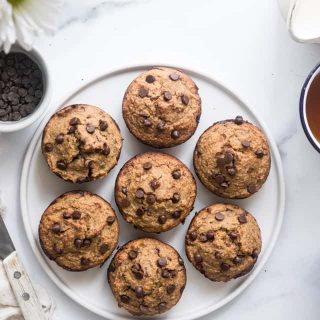 Healthy Zucchini Bread Muffins - These dairy free Zucchini Muffins are fluffy and gluten, dairy, oil and sugar free! Sweetened with dates, studded with chocolate chips and only 170 calories! Great for kids and adults! | #Foodfaithfitness |