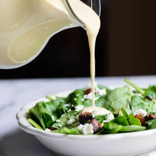 Miso Lemon Tahini Dressing - This Miso Lemon Tahini Dressing Recipe is an easy, creamy dressing that is big on taste, only 35 calories and is SO easy to make! Garlicky, sweet, tangy and so addicting! | #Foodfaithfitness | #Glutenfree #Vegan #healthy #Nutfree #Sugarfree