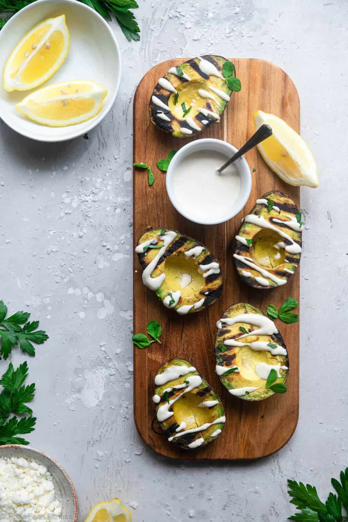 Grilled Avocado with Feta Tahini Sauce - These smoky and creamy grilled avocados are drizzled with a sweet and tangy feta and tahini sauce for an easy summer dinner that's healthy , keto, low carb and delicious! | #Foodfaithfitness | #Glutenfree #healthy #lowcarb #keto #grilling