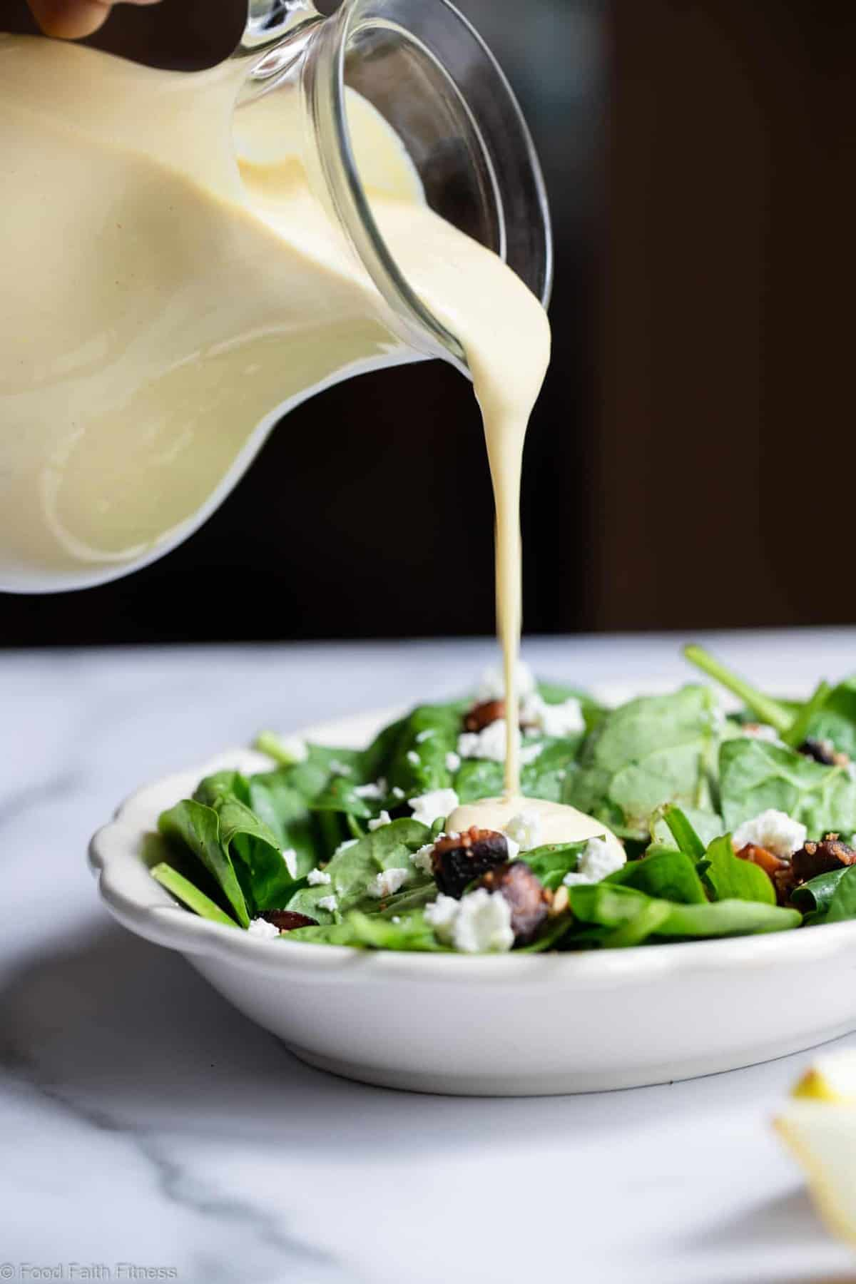 pouring tahini salad dressing onto a salad
