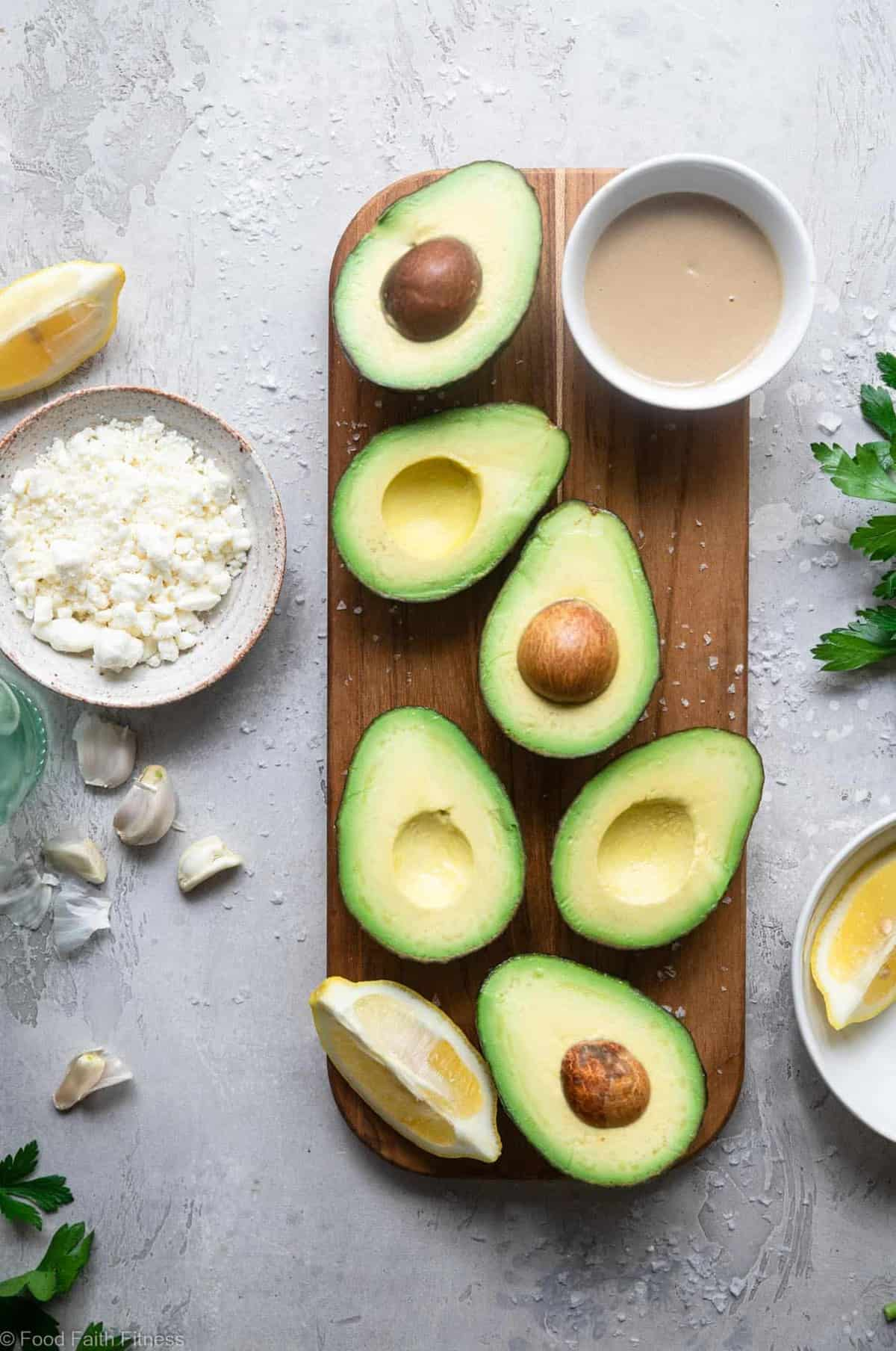 Grilled Avocado with Feta Tahini Sauce - These smoky and creamy grilled avocados are drizzled with a sweet and tangy feta and tahini sauce for an easy summer dinner that's healthy , keto, low carb and delicious! | #Foodfaithfitness |