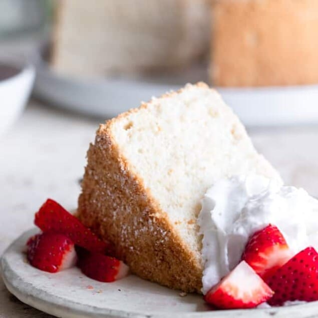 Sugar Free Angel Food Cake - This whole grain, healthy and sugar free Angel Food Cake is light, fluffy and tender! It tastes better than boxed mixes and is just as easy to make! You'll never believe it's lower carb and 50 calories! | #Foodfaithfitness | #Lowcarb #sugarfree #healthy #angelfoodcake #cake