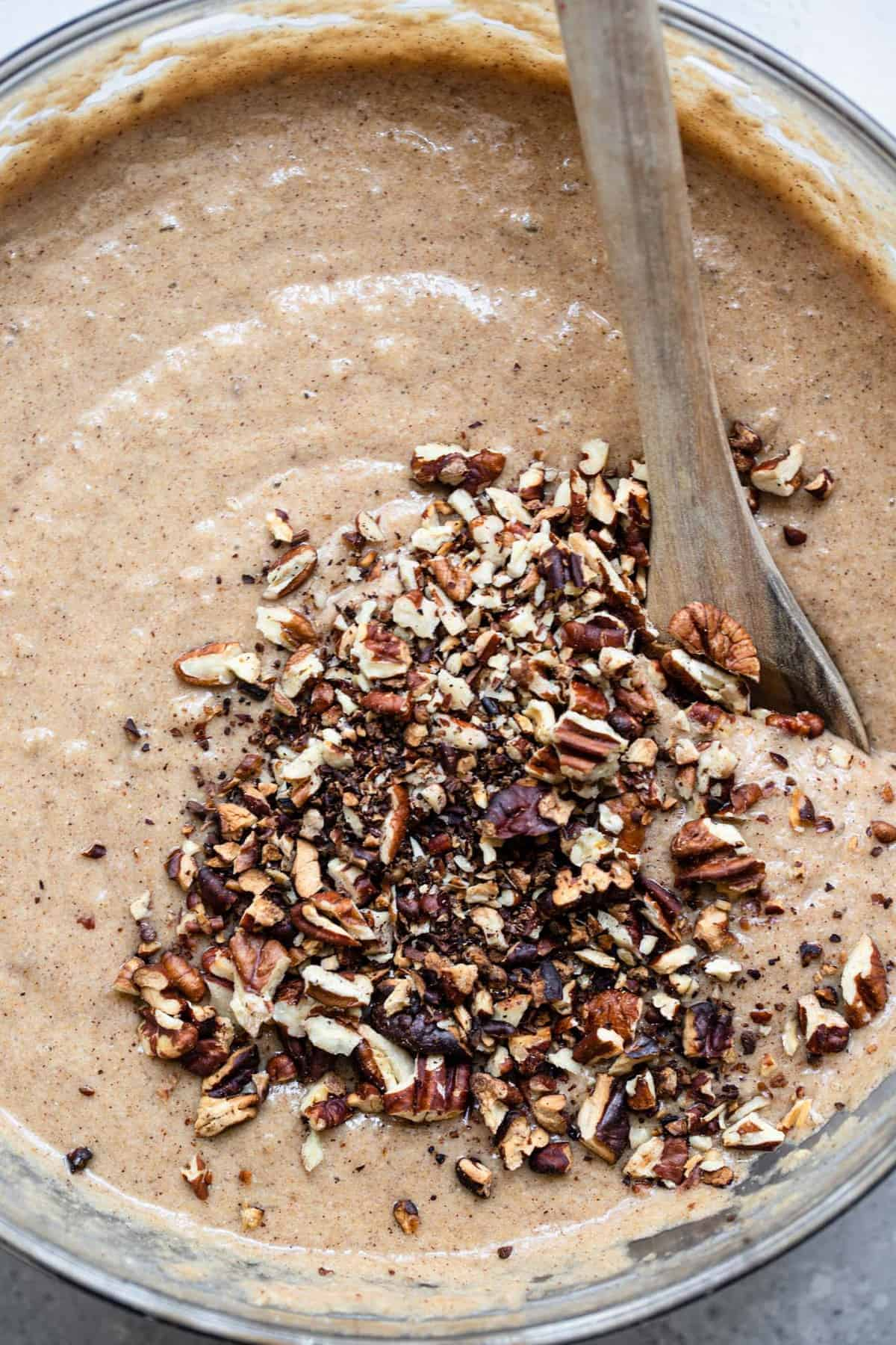 The batter of sugar free banana bread with chopped pecans