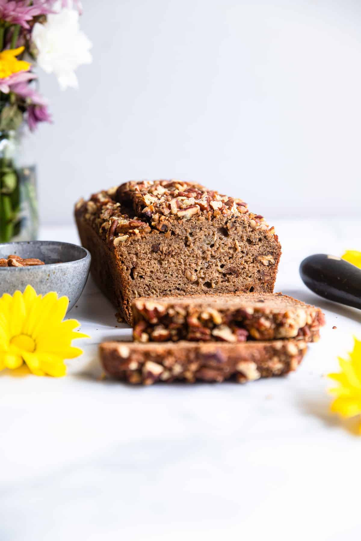 Sugar free banana bread sliced and sitting on a table
