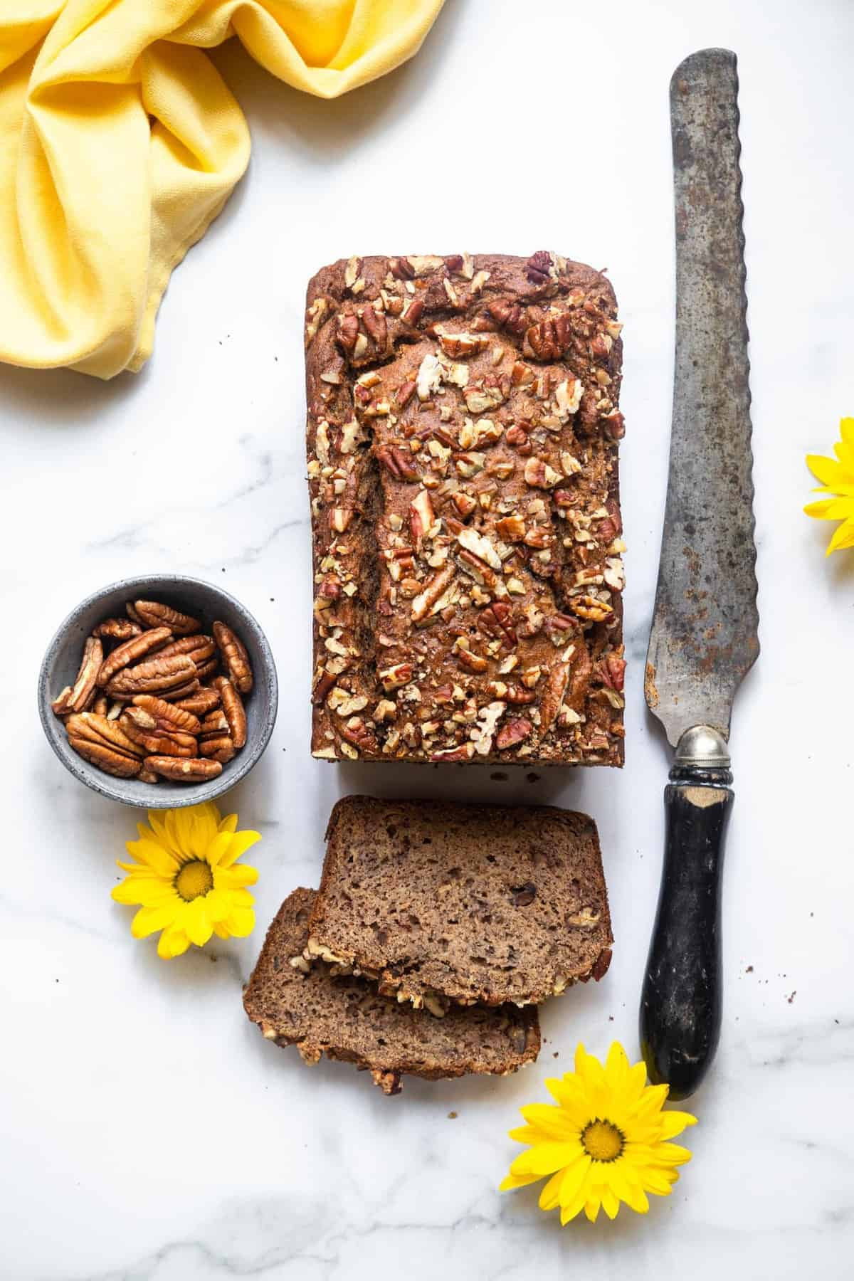over head photo of a Sugarless banana bread on a table top