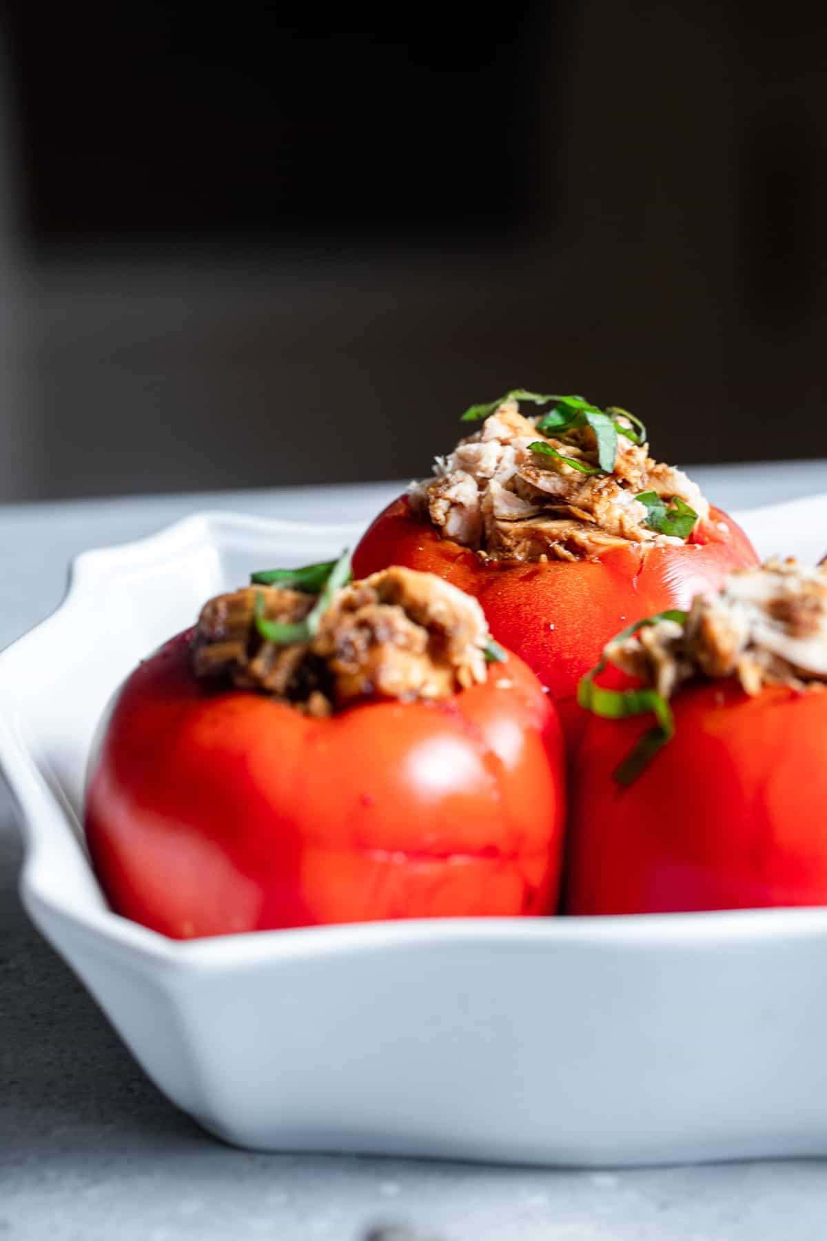 tuna stuffed tomatoes in a serving dish