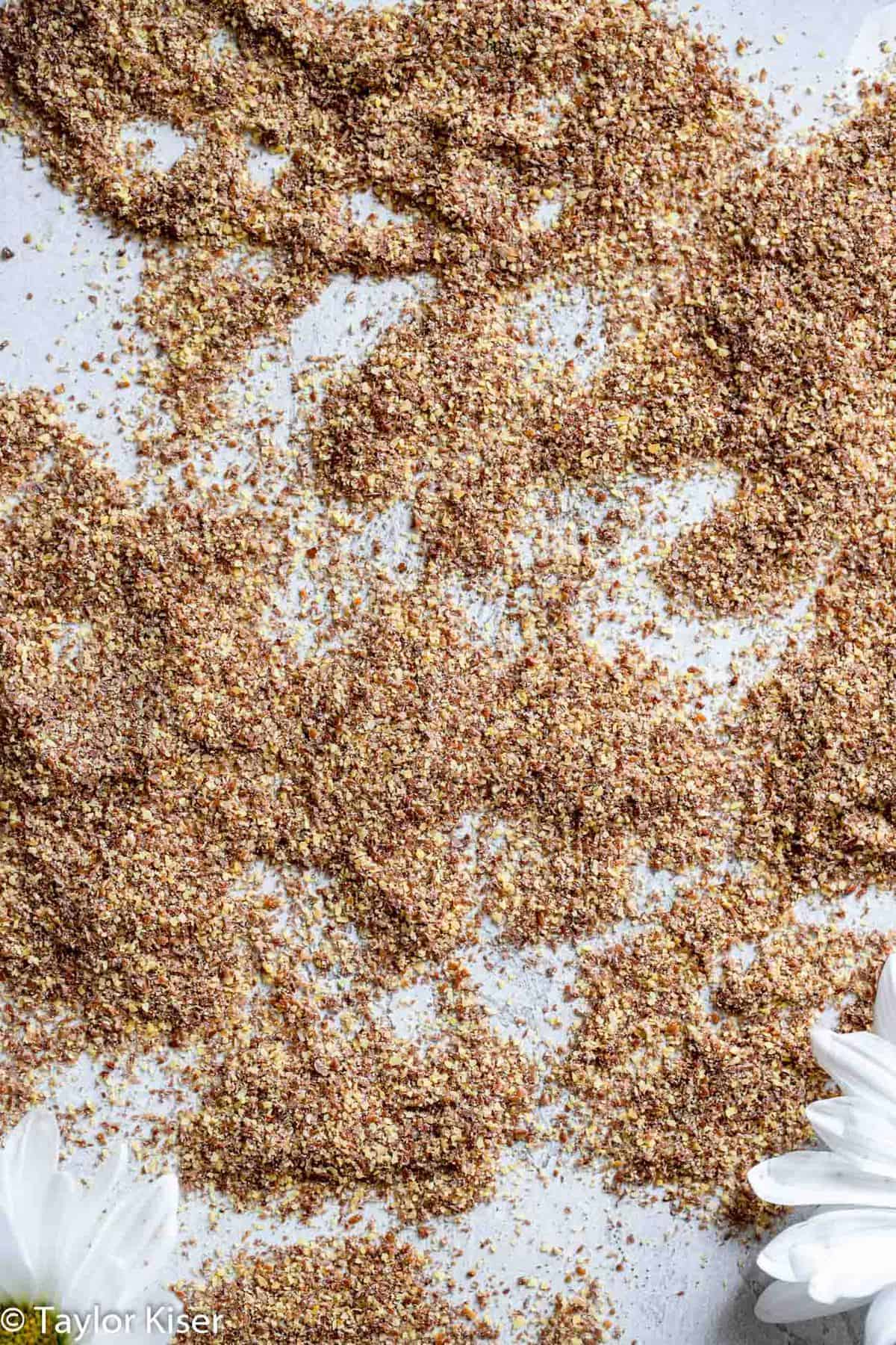 flax seeds spread on a table for Banana Flaxseed Smoothie
