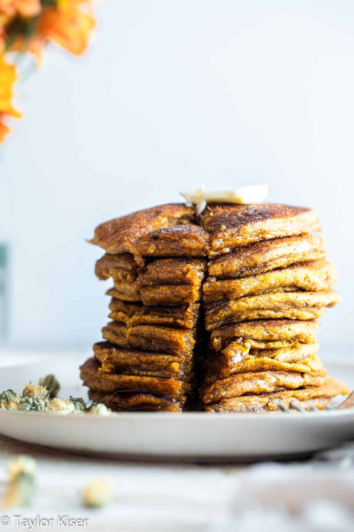 A stack of whole wheat healthy pumpkin pancakes with butter