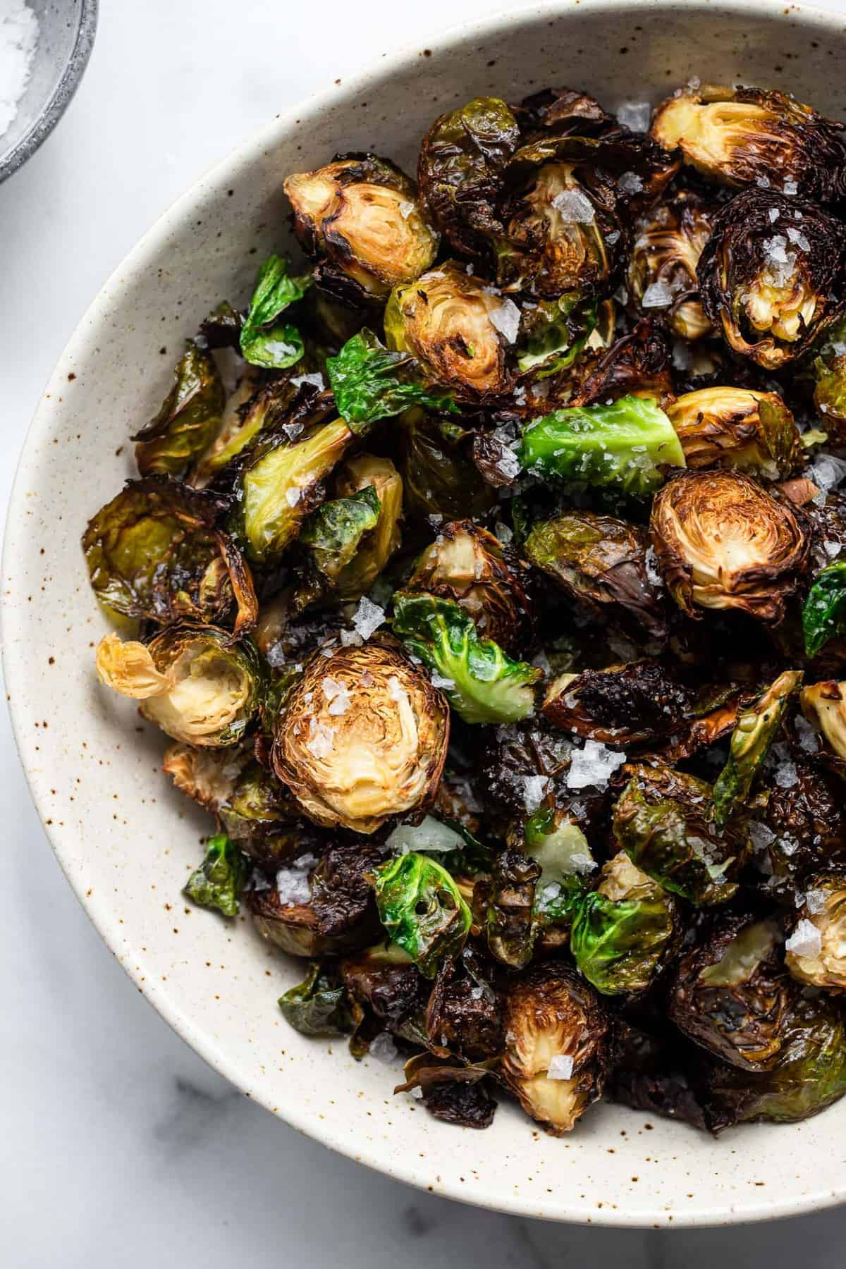 close up of a bowl of crispy air fryer brussels sprouts