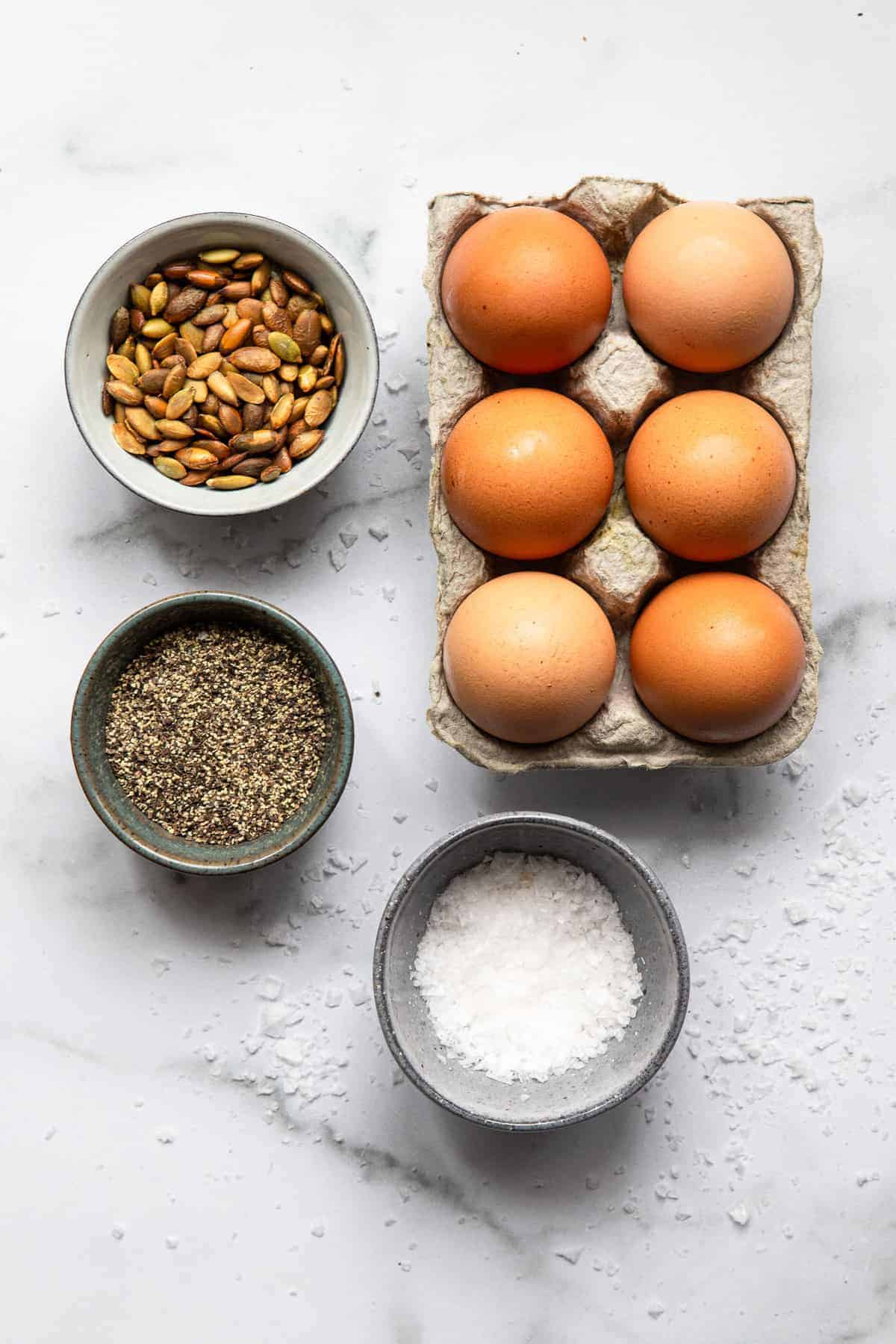 ingredients to make a hard boiled egg snack on a table