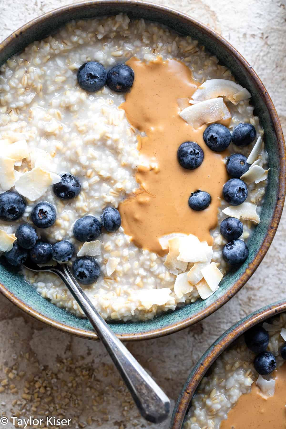 overnight steel cut oats topped with blueberries and nut butter