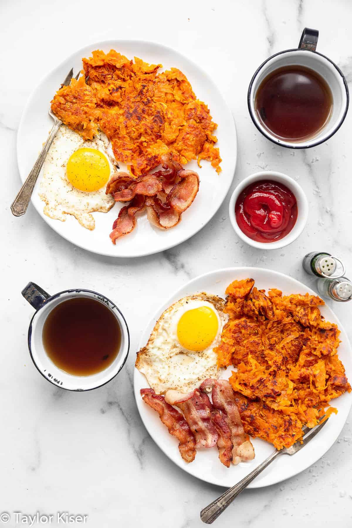 shredded sweet potato hash browns on a plate with eggs