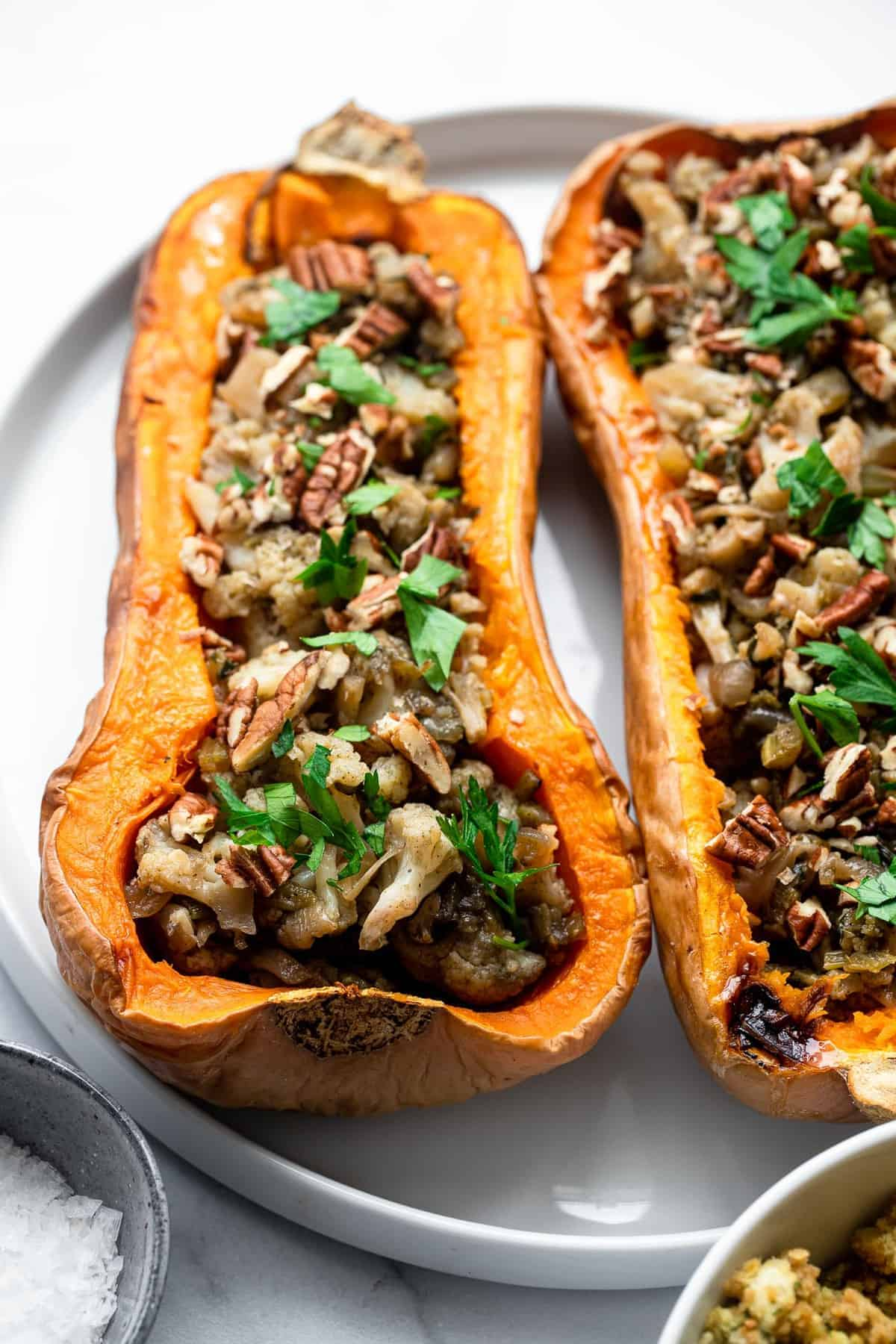 vegan stuffed butternut squash on a plate