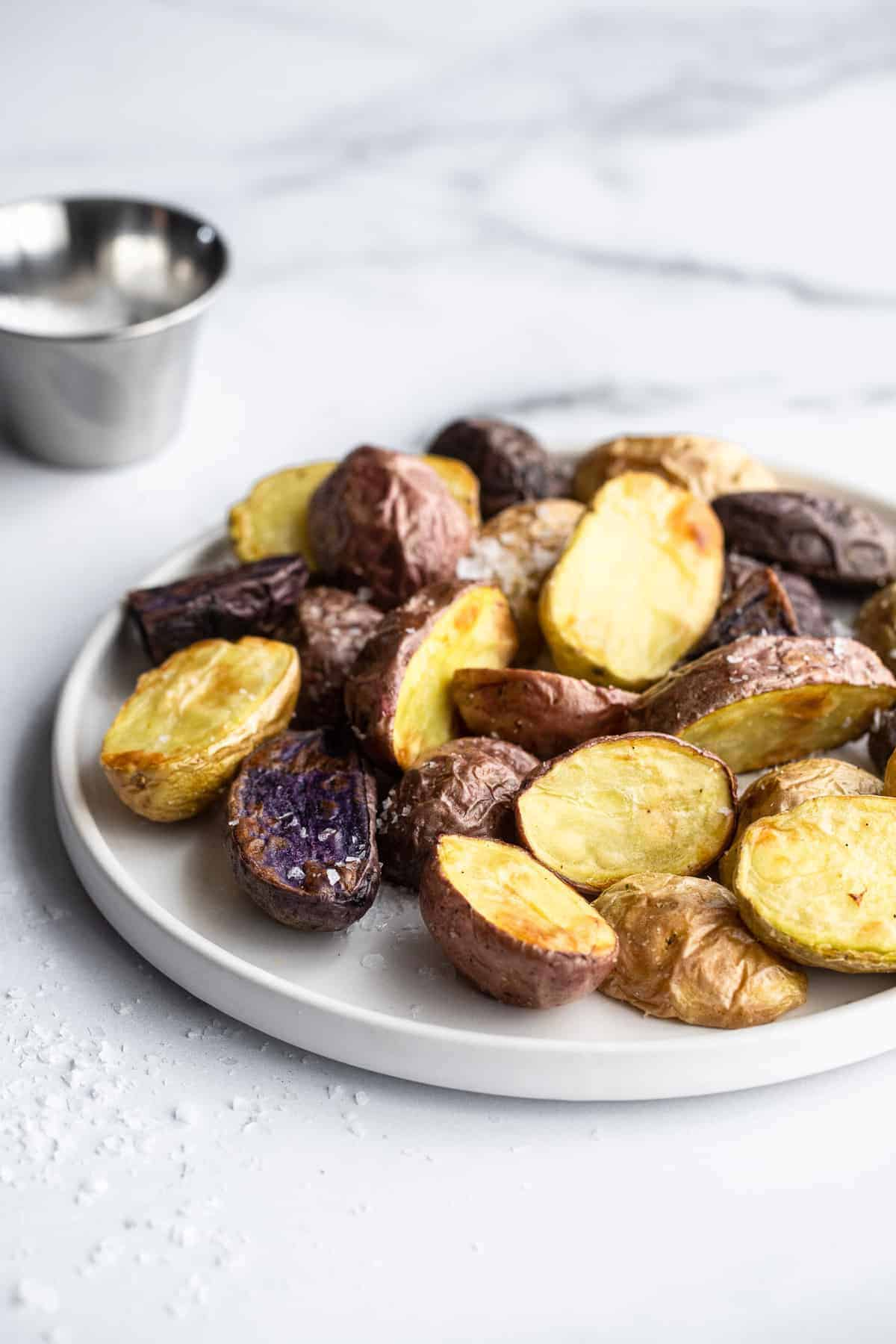 a pile of air fryer roasted potatoes on a plate