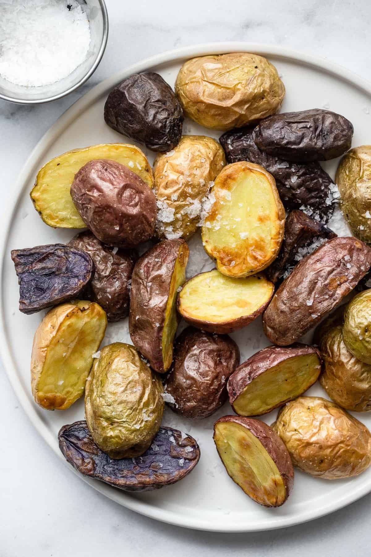 colorful air fryer roasted potatoes on a gray plate