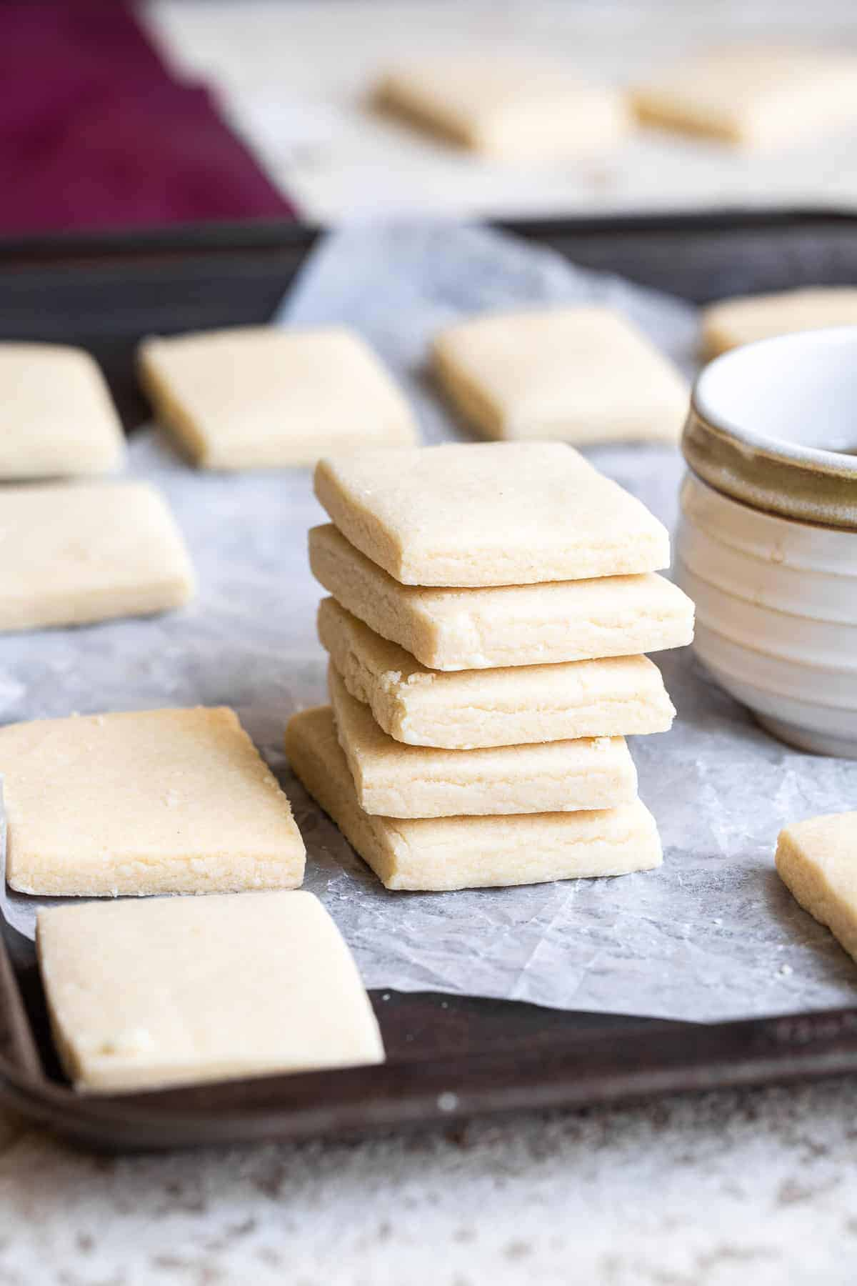 a stack of healthy shortbread cookies on a cookie sheet