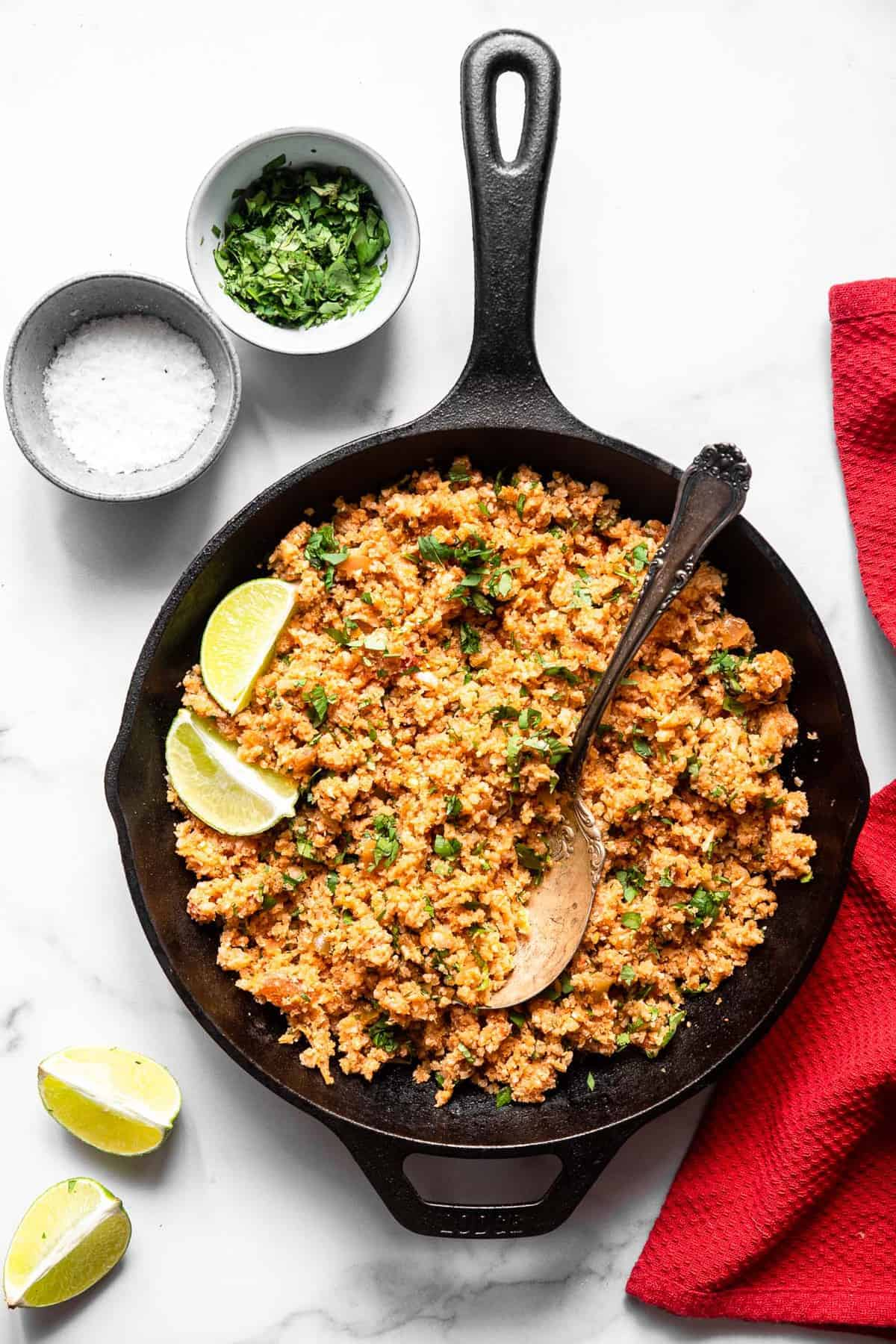 mexican caulil rice in a black cast iron skillet on a table