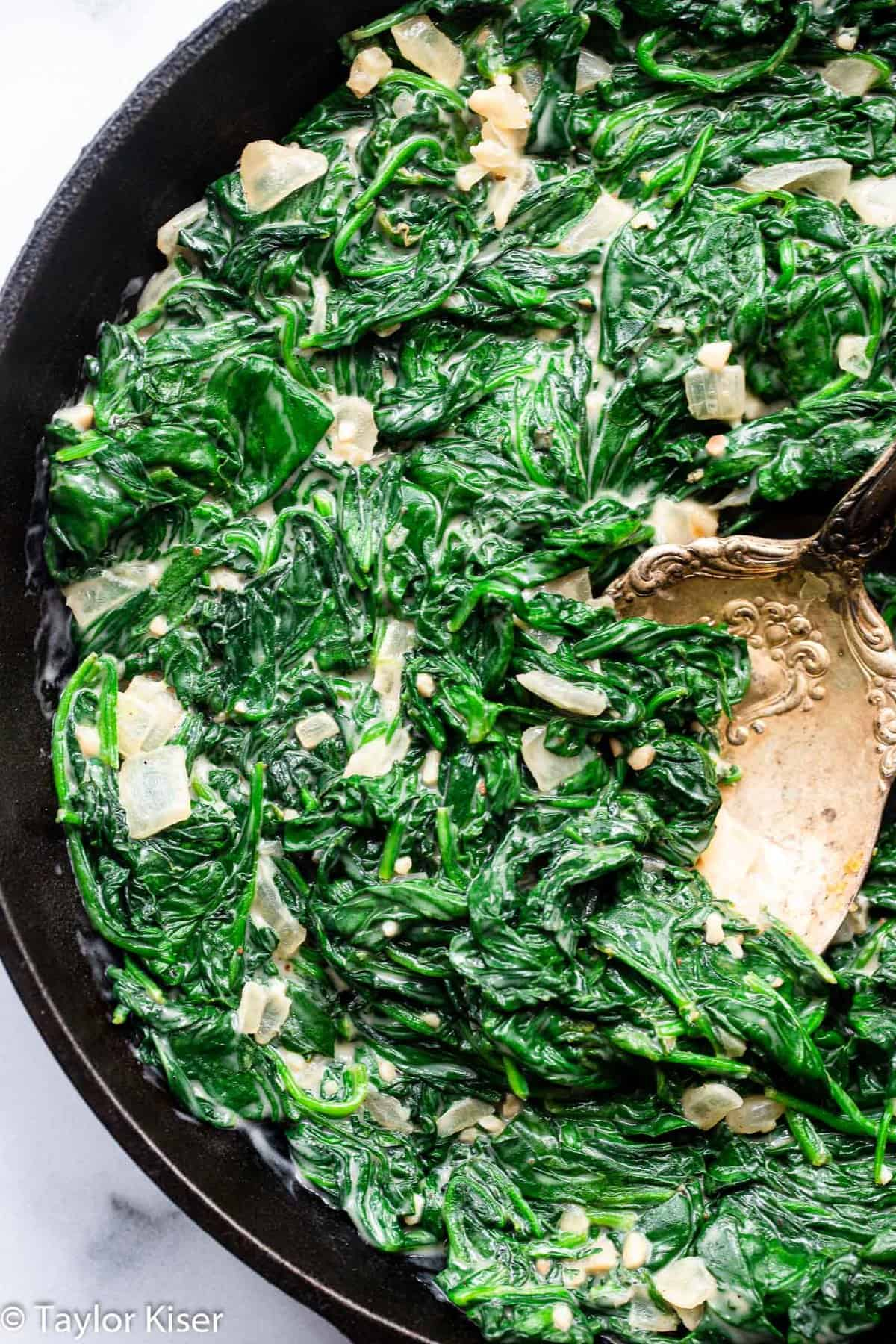 overhead angle of a cast iron skillet with low carb creamed spinach