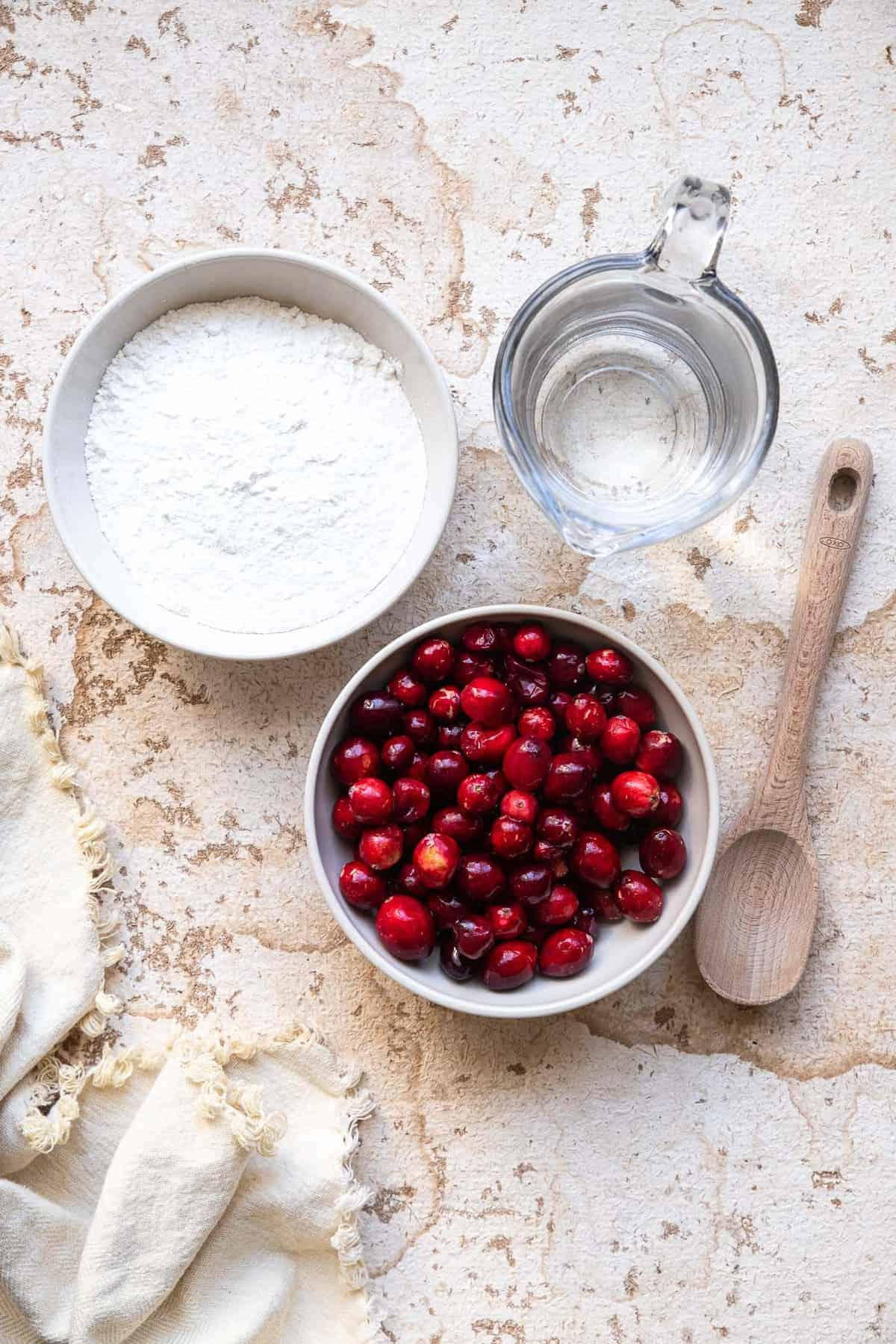 ingredients to make low carb keto cranberry sauce in bowls